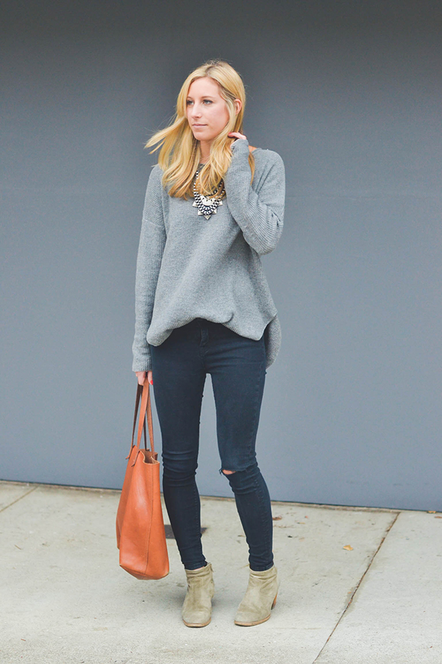 black skinny jeans and gray sweater