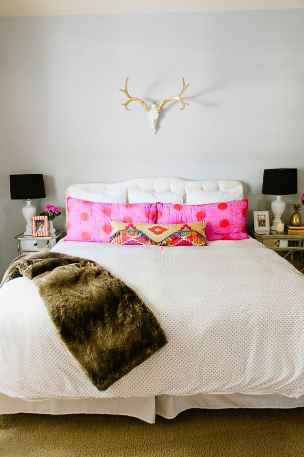 deer antlers above the bed