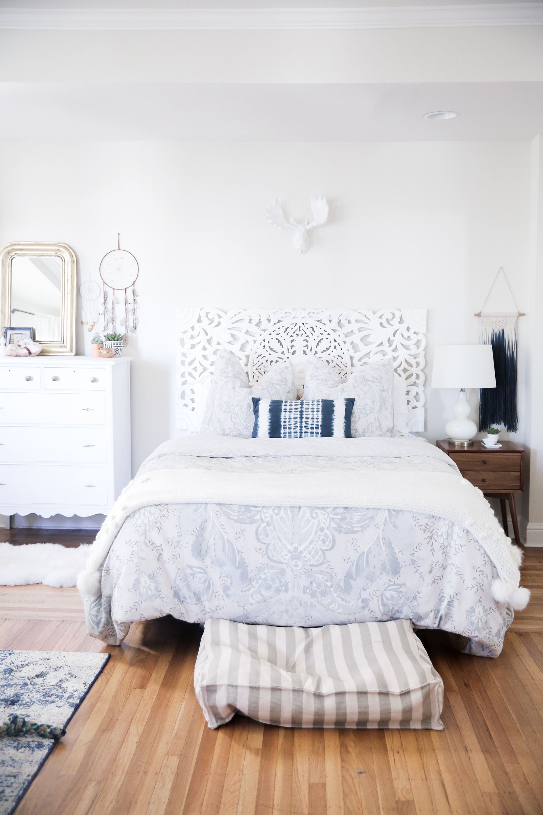 top 10 popular posts of 2015 from Advicefroma20Something.com, all white bedroom, white and blue bedroom, urban outfitters home decor, anthropologie home decor, white headboard, stylish dog bed, anthropologie bedding, boho decor, bright bedroom ideas, decor ideas