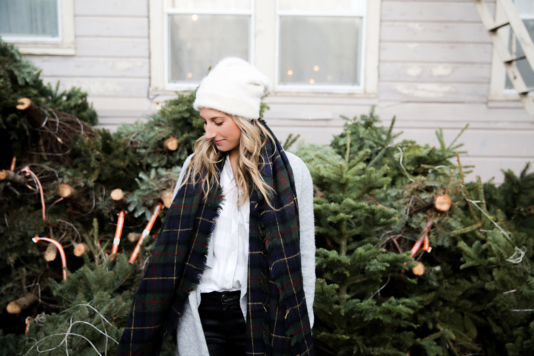 A visit to the christmas tree lot in plaid scarf