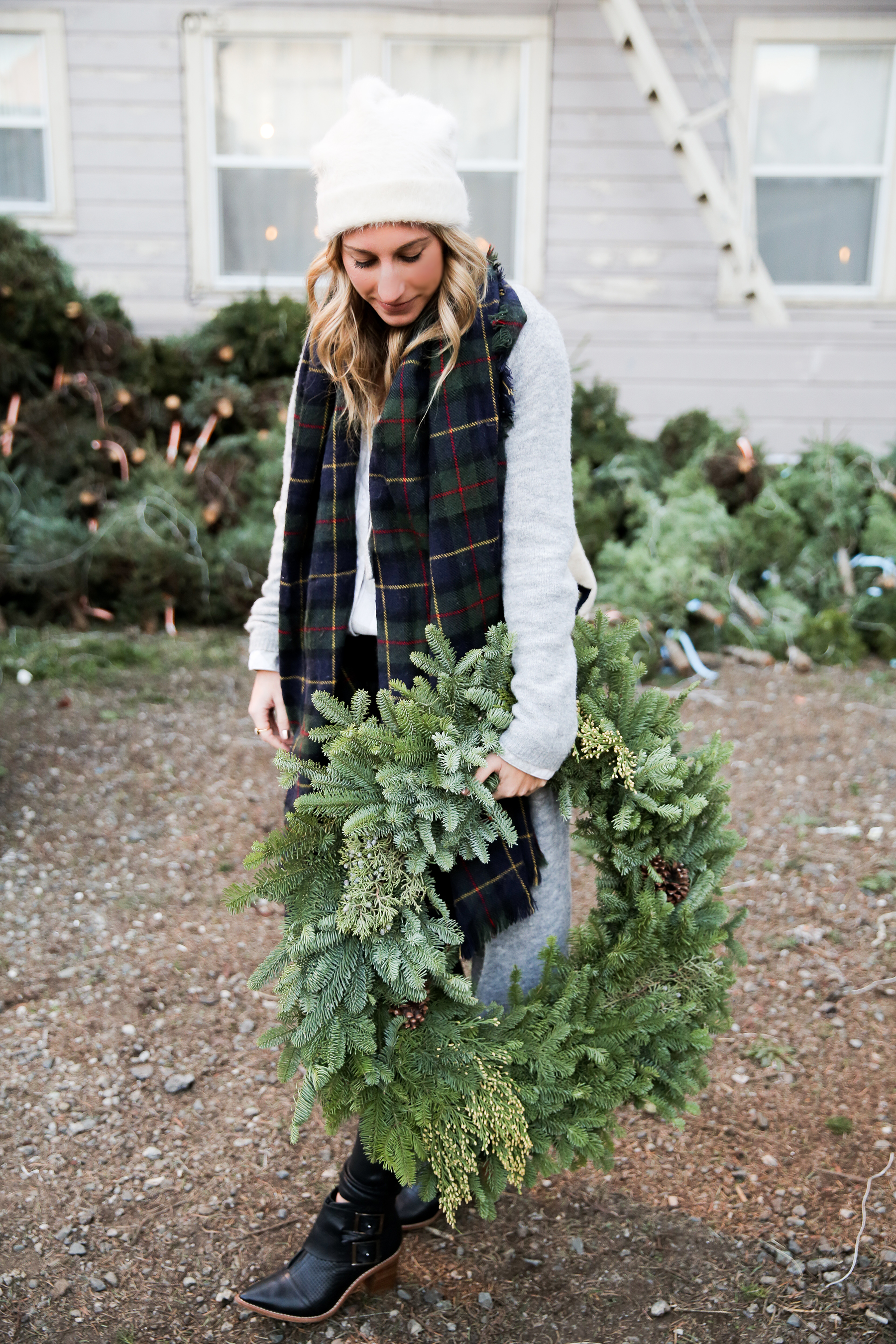 christmas tree lot outfit, holiday outfit, plaid scarf, gray cardigan, holiday outfit ideas, winter outfits, black ankle boots, faux leather pants, photos by Andrea Posadas of Amanda Holstein for Advicefroma20Something.com