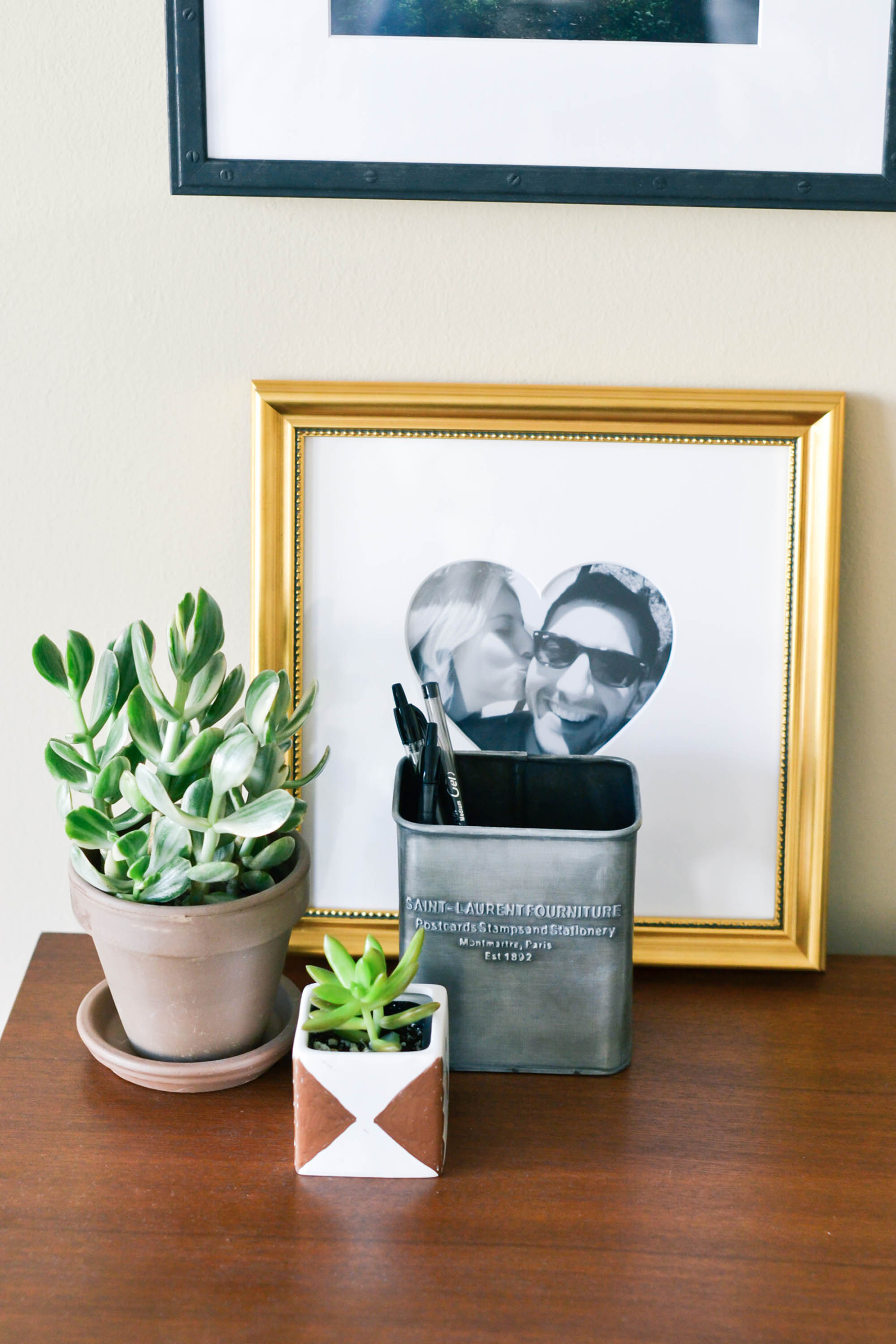 framebridge gallery wall, stylish frames, custom frames, decorating guys apartment, masculine decor, masculine apartment decor, succulents, photography by Amanda Holstein for Advicefroma20Something.com
