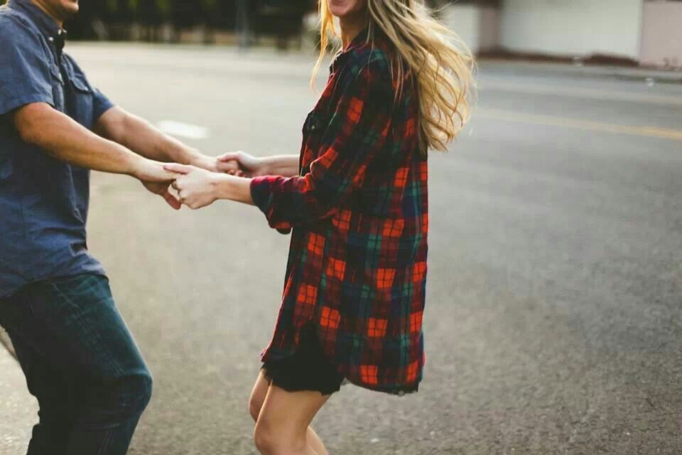 couple dancing in the street in plaid shirt