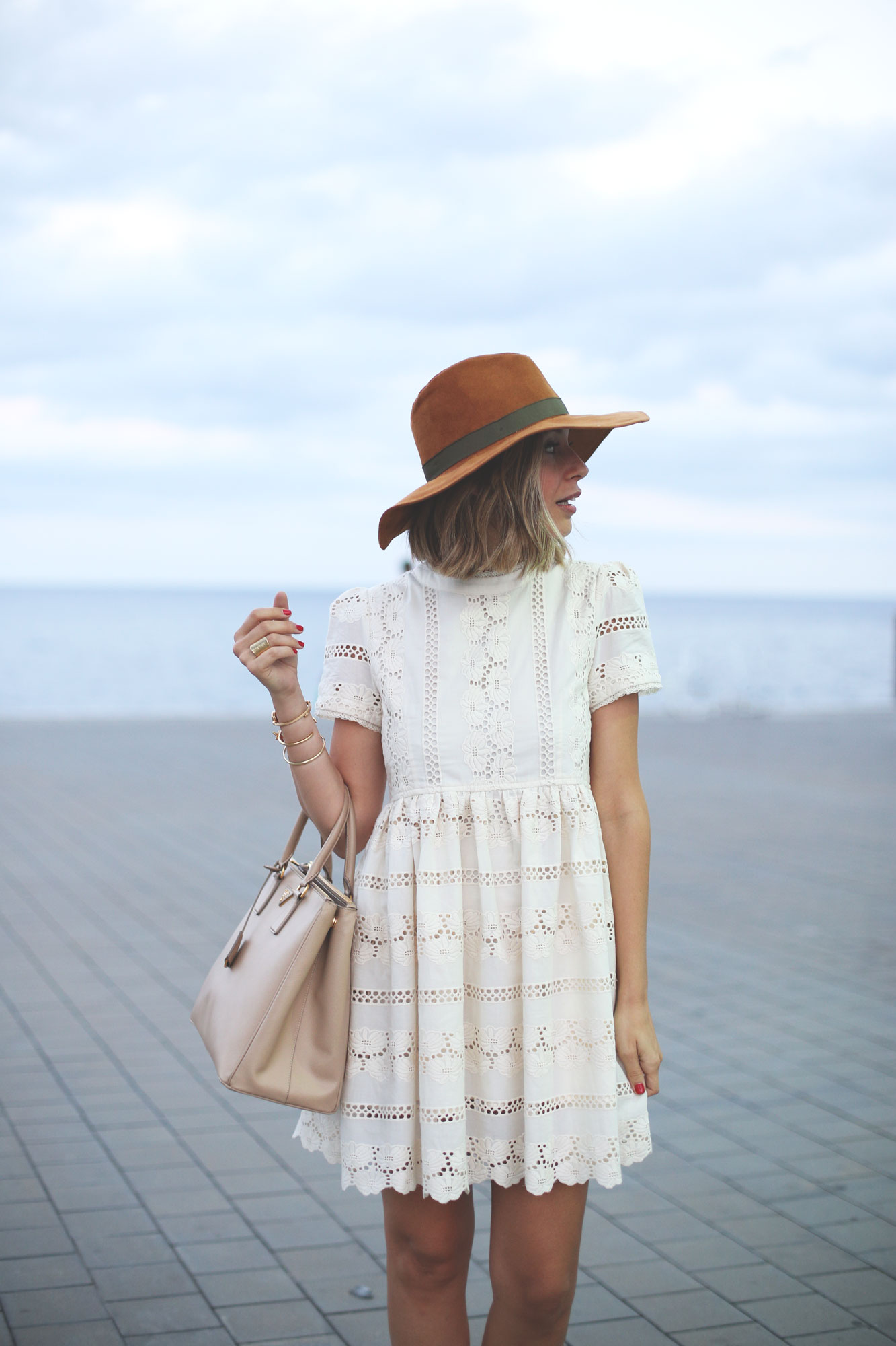 tan hat and white lace dress