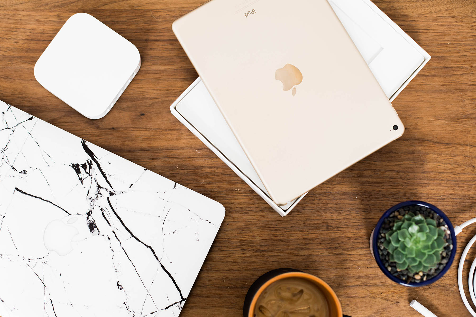 Apple products on coffee table, Airport, iPad and Macbook Pro with marble cover