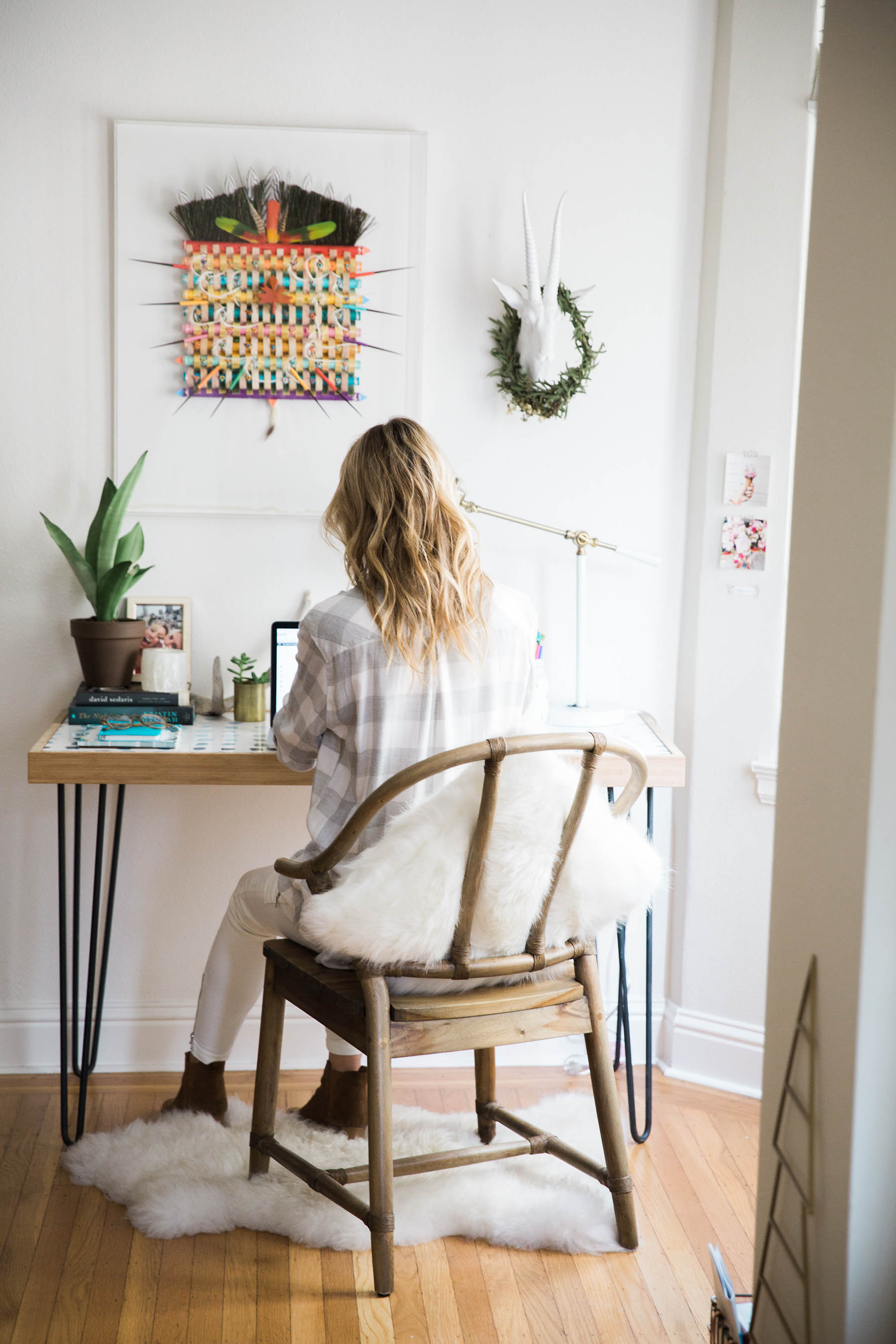 Amanda Holstein working at boho desk, tips on being more productvie