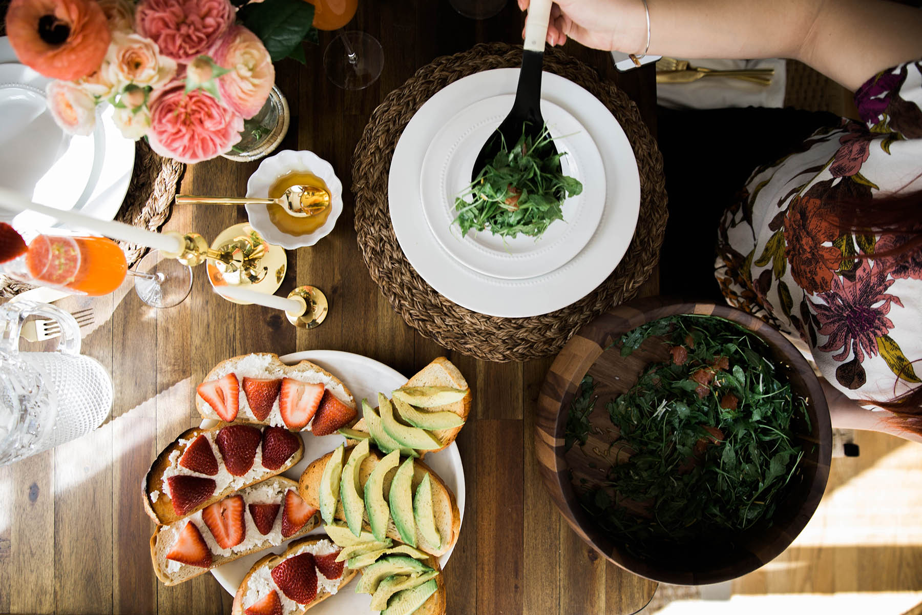 spring brunch setting with avocado toast and arugula salad