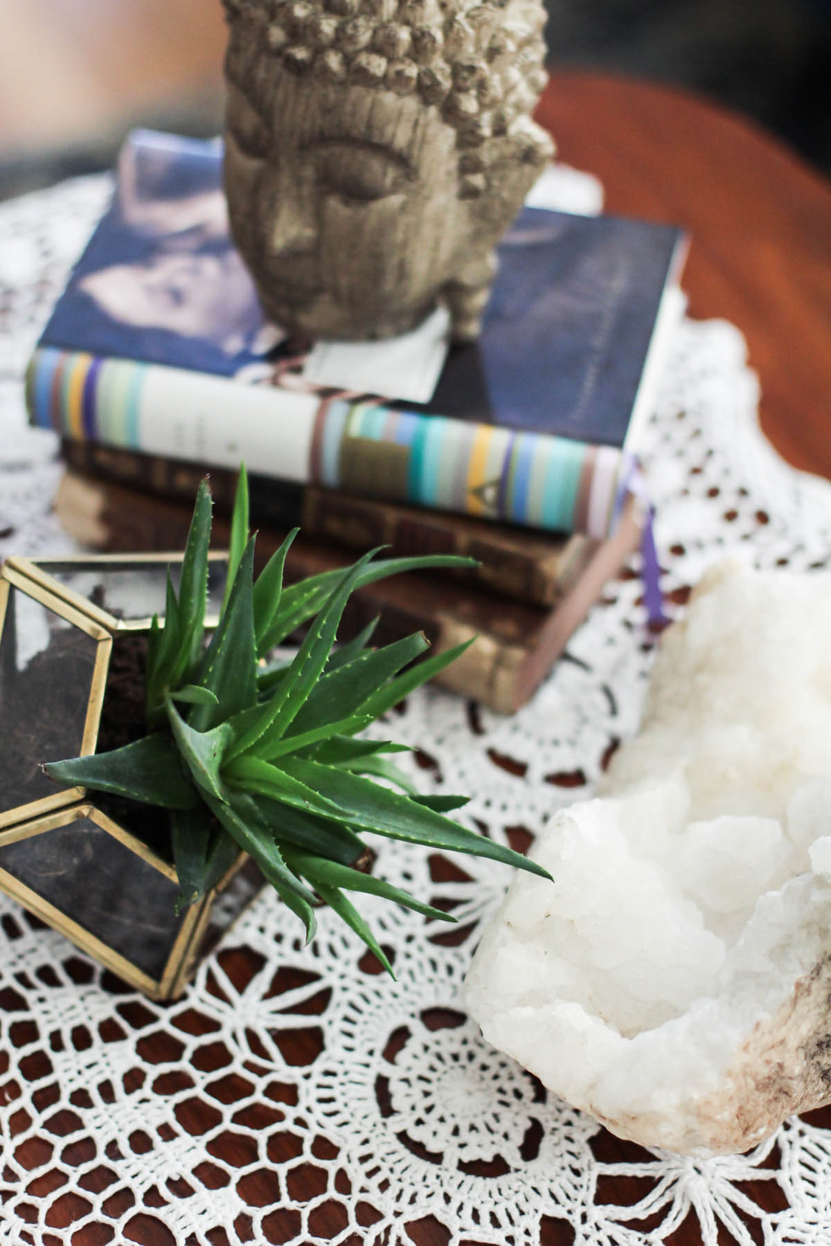 boho coffee table decor with succulent terrarium, geode, and buddha