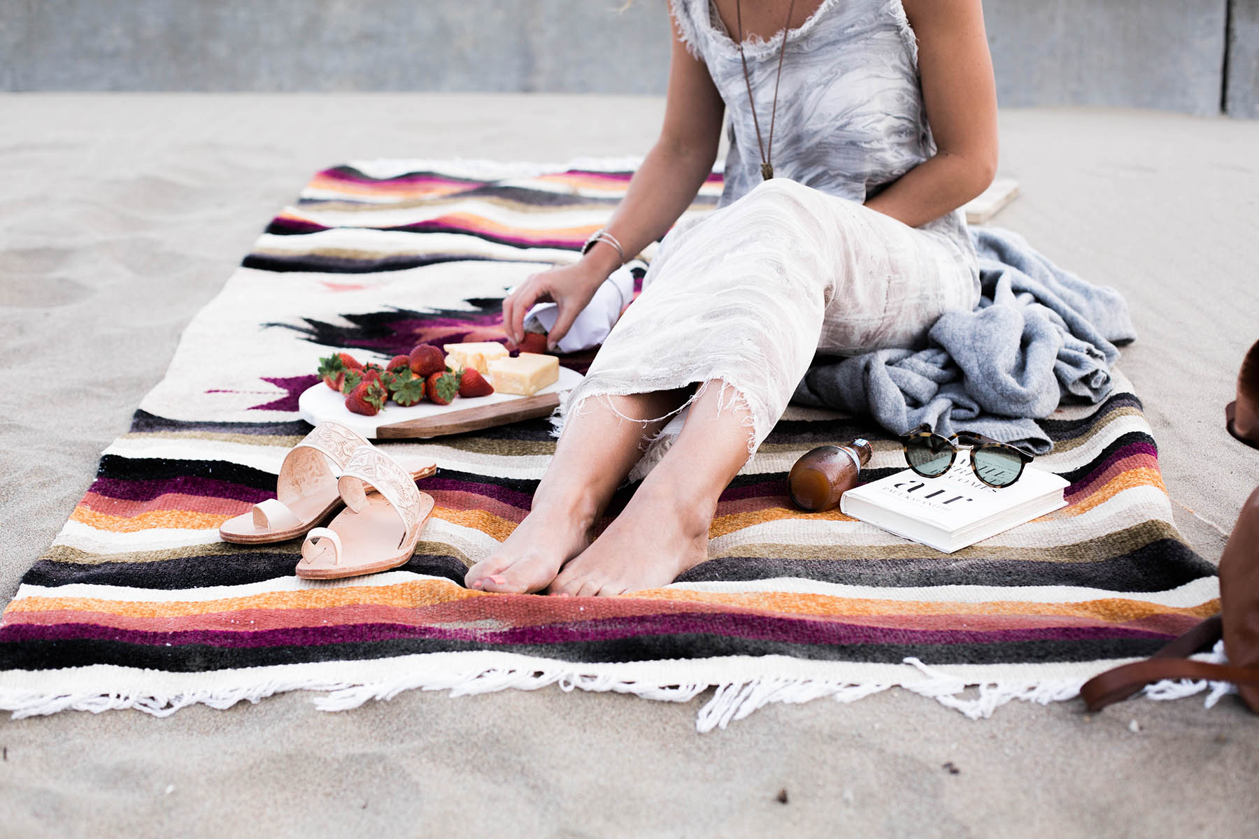 beach picnic with mexican blanket and beek sandals