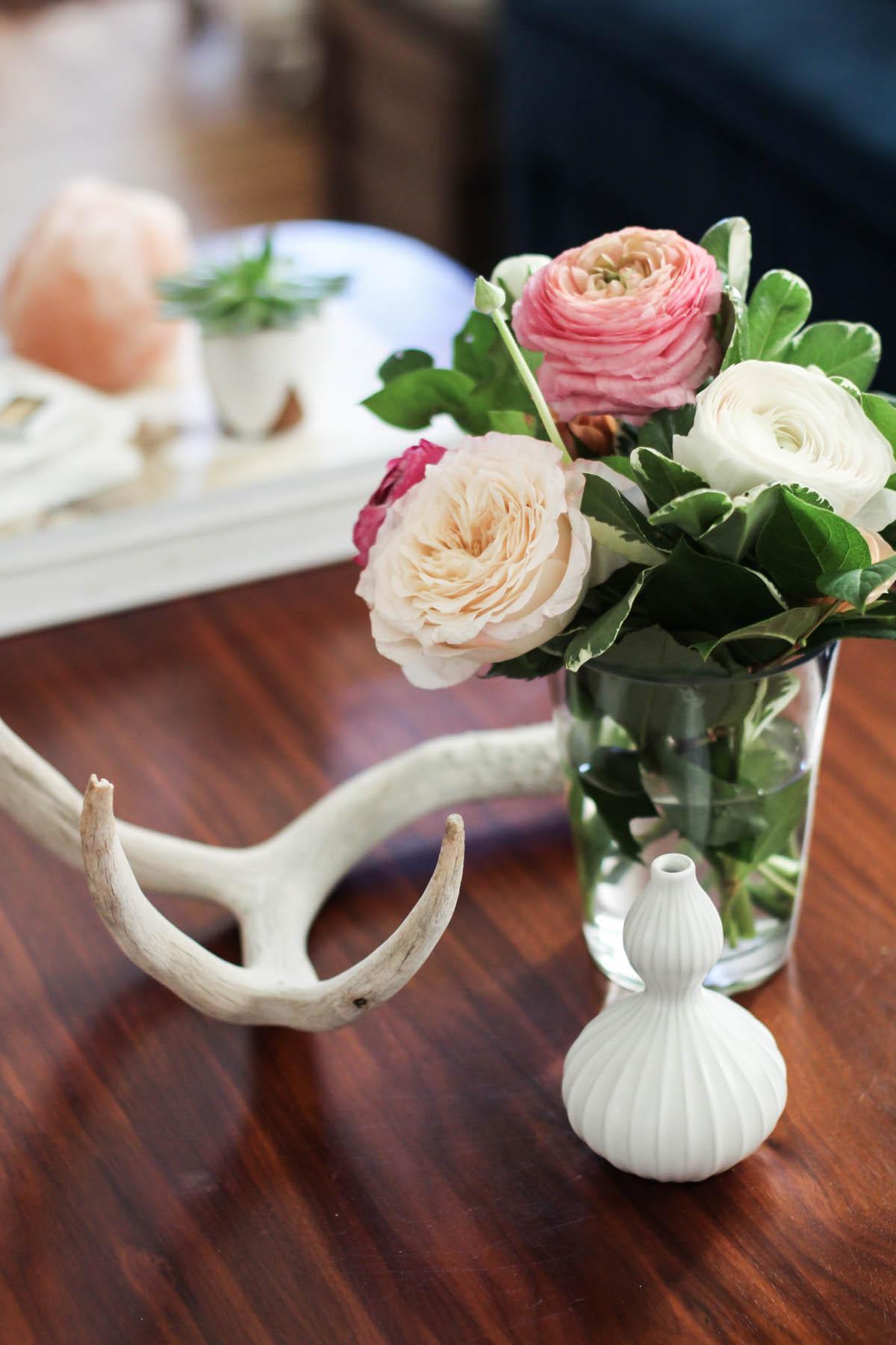 feminine coffee table styling with Jonathan Adler bud vase