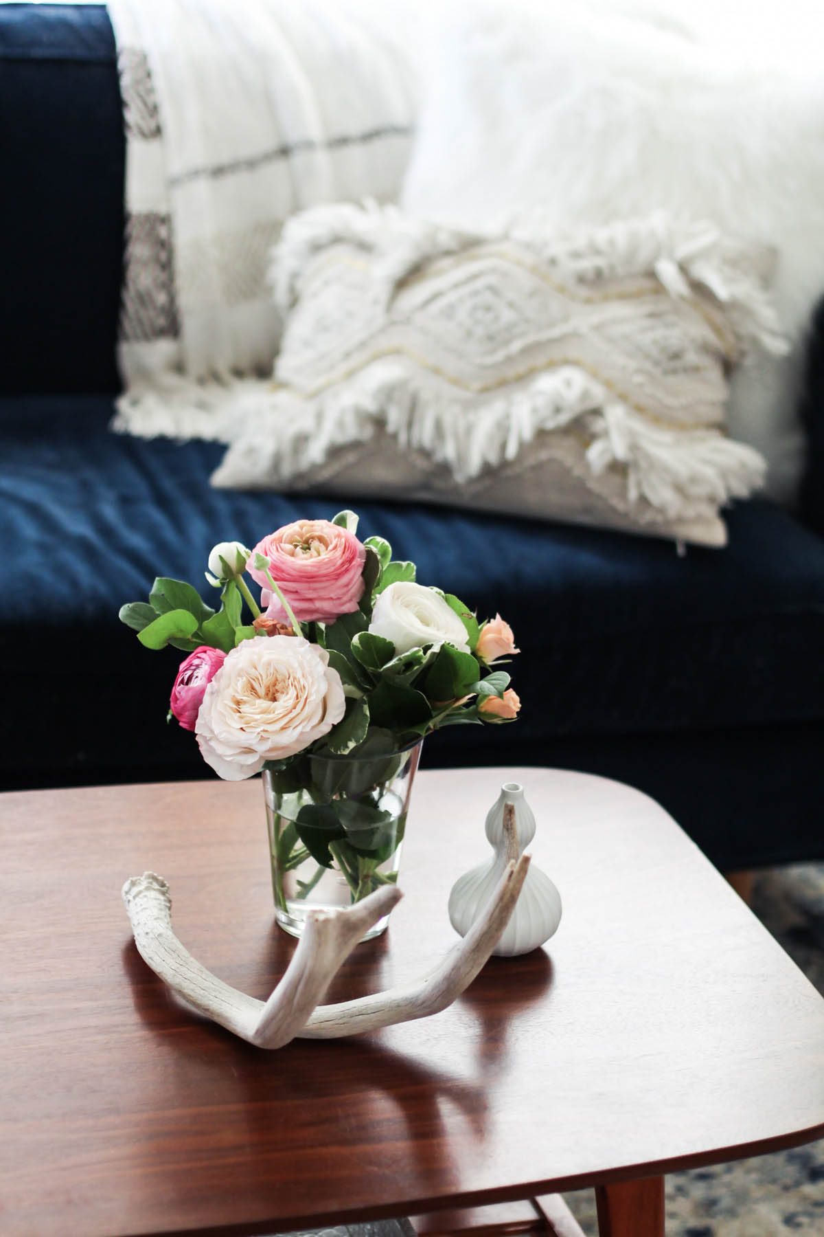 feminine coffee table styling with flowers and antlers