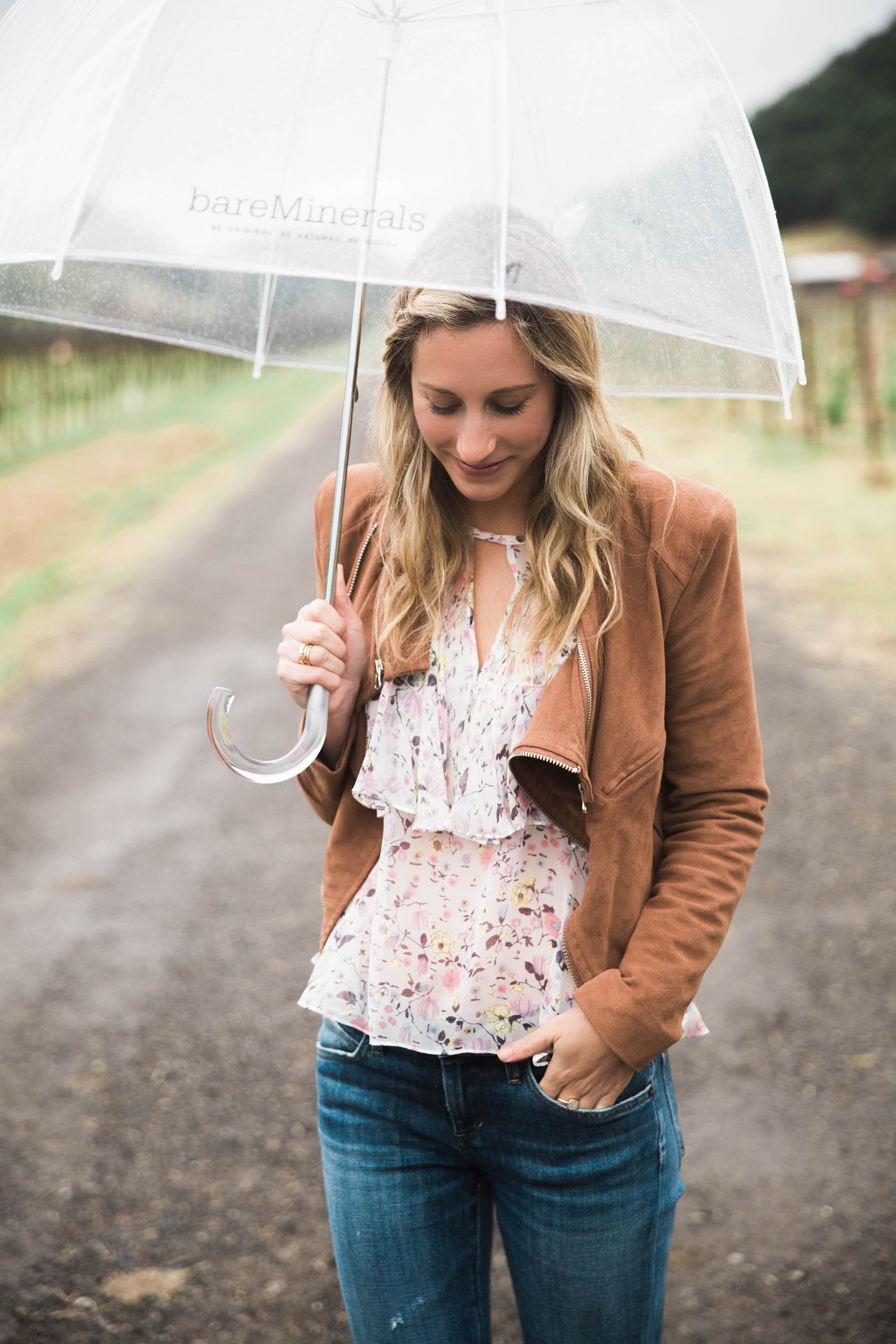 Amanda Holstien in Napa in floral blouse and brown suede jacket
