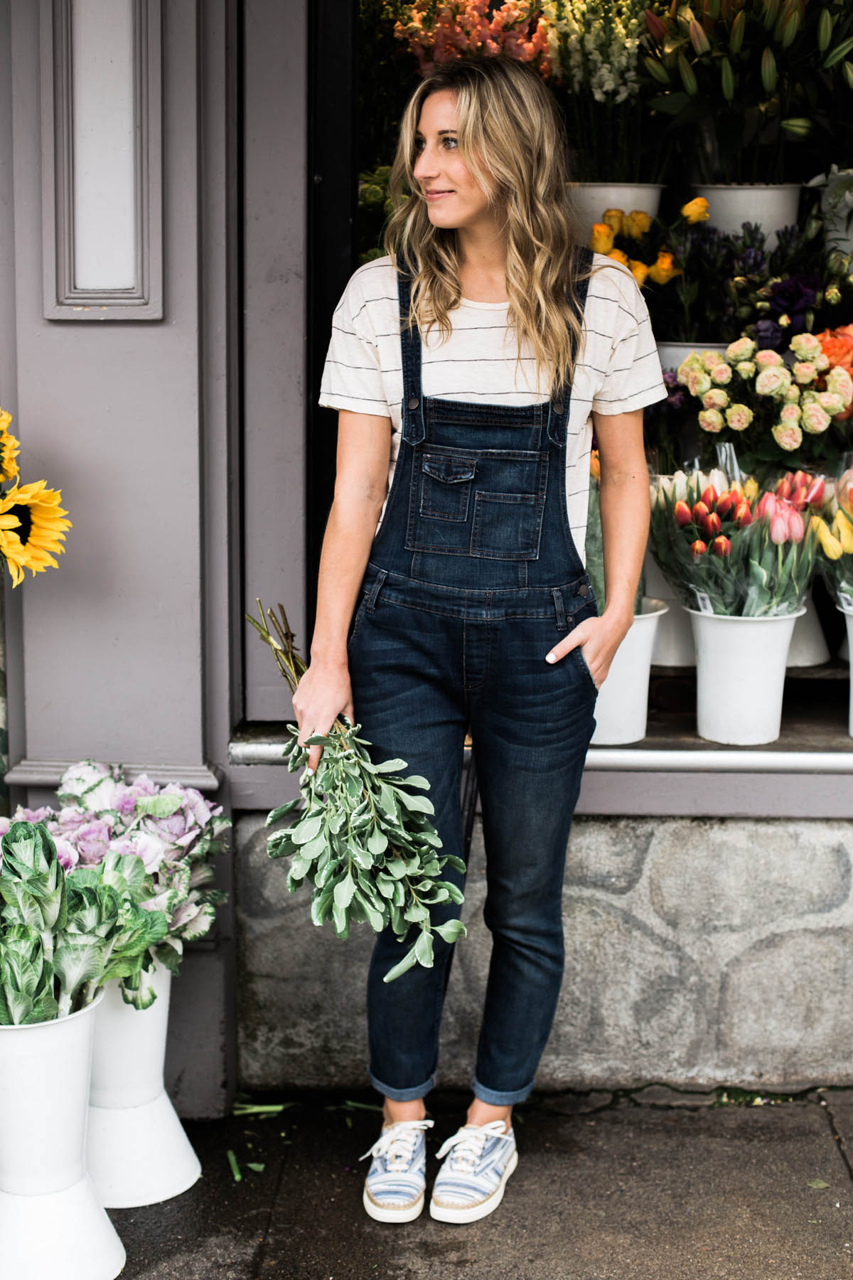 Free People denim overalls, Madewell striped tee, and wavy blonde hair
