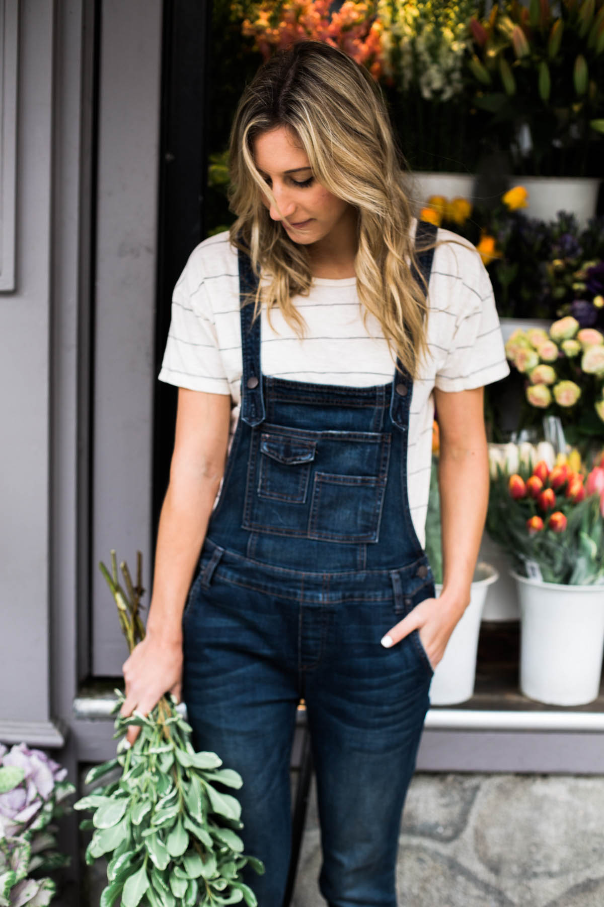 Amanda Holstein in Free People denim overalls and Madewell striped tee