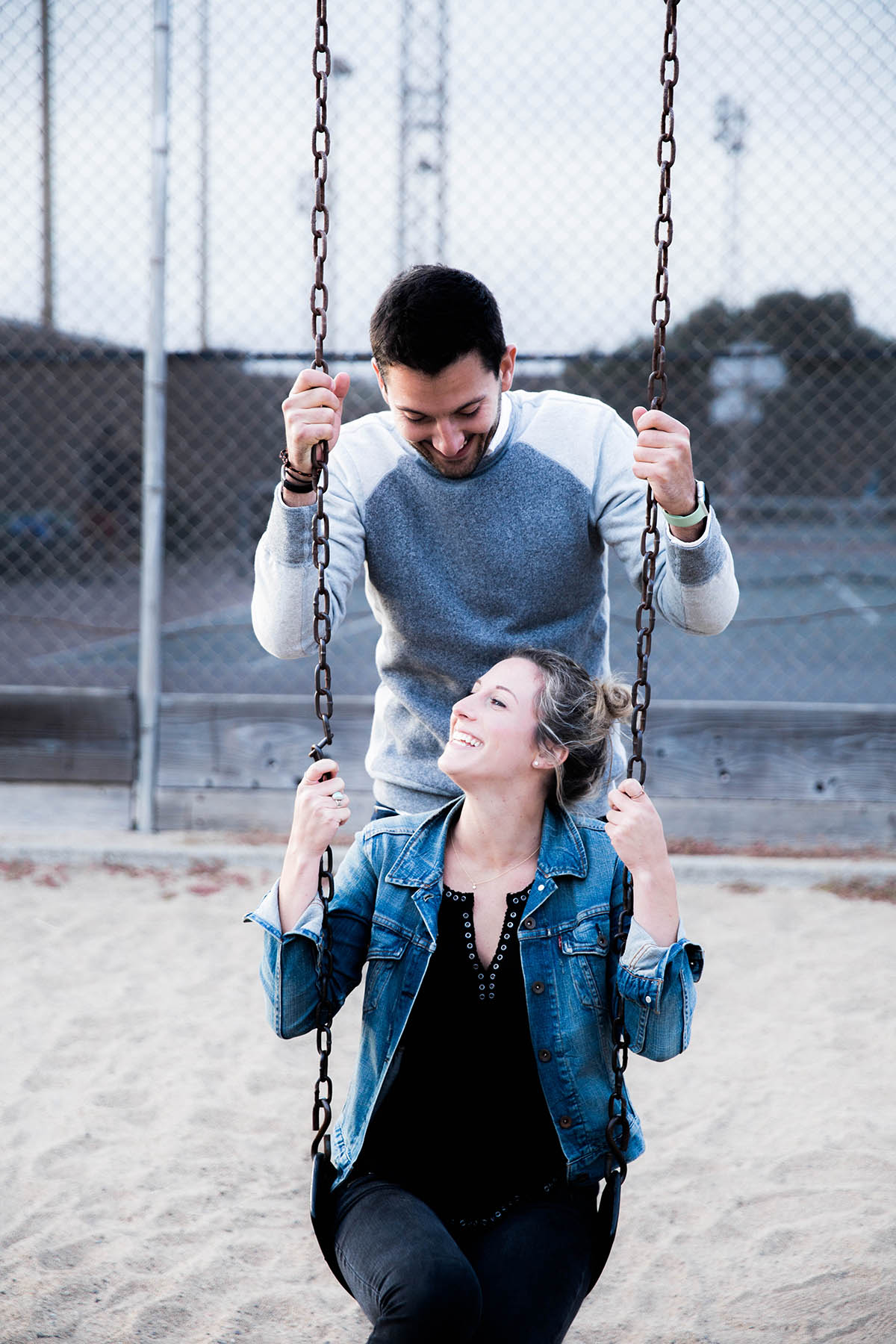 Amanda Holstein young couple on the swings