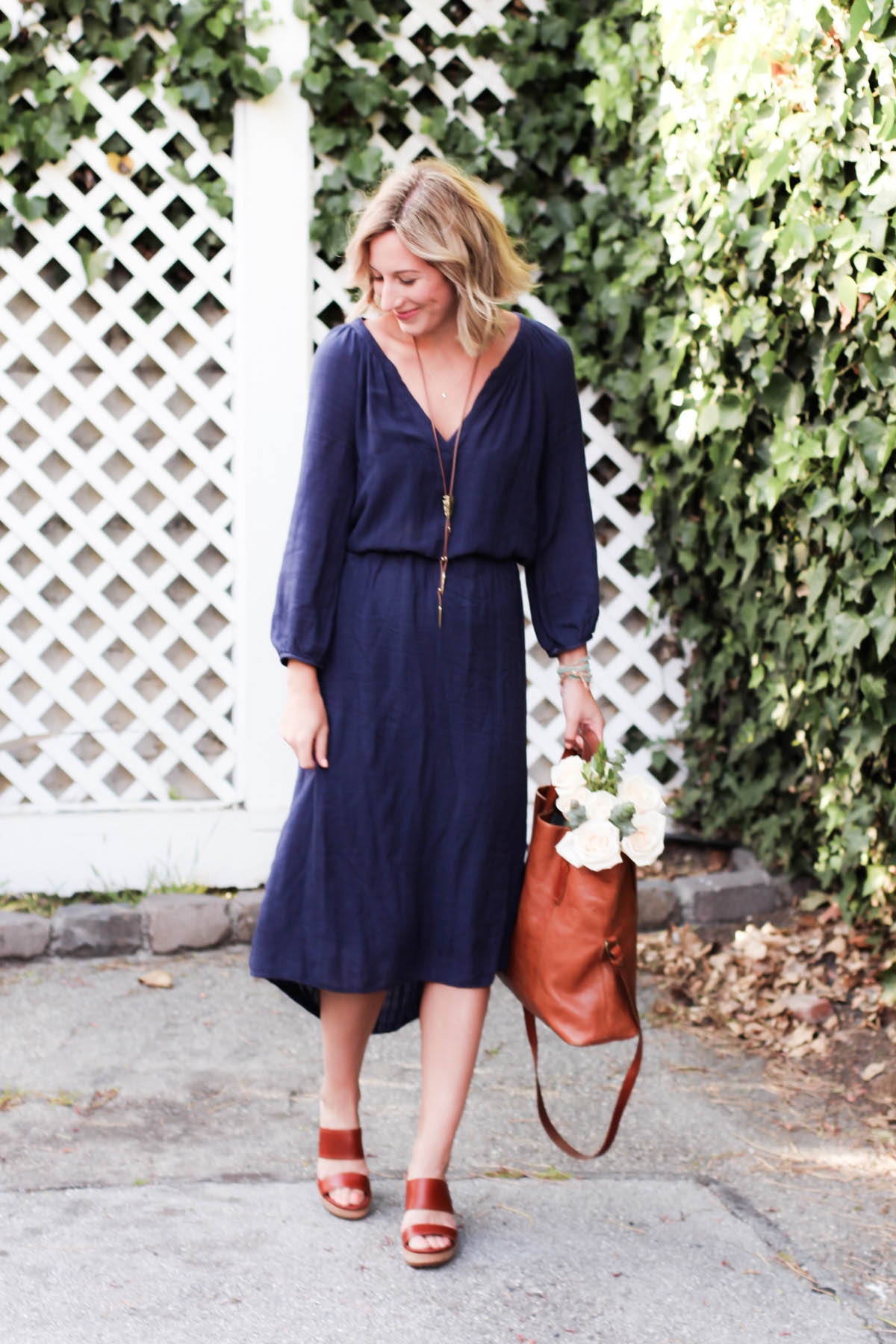 Amanda Holstein in spring outfit navy dress and leather sandals