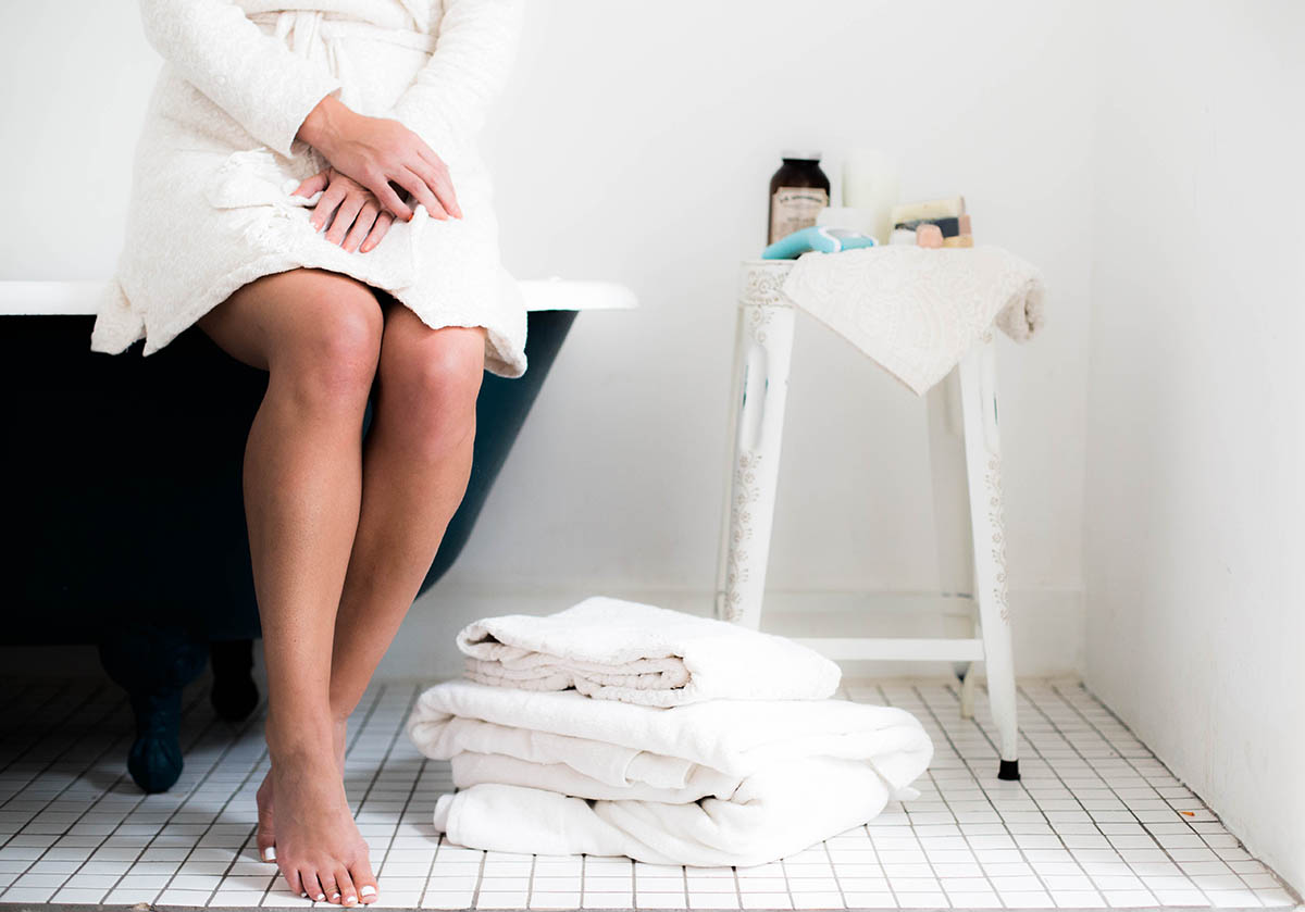 at-home pedicure tutorial in white bathroom
