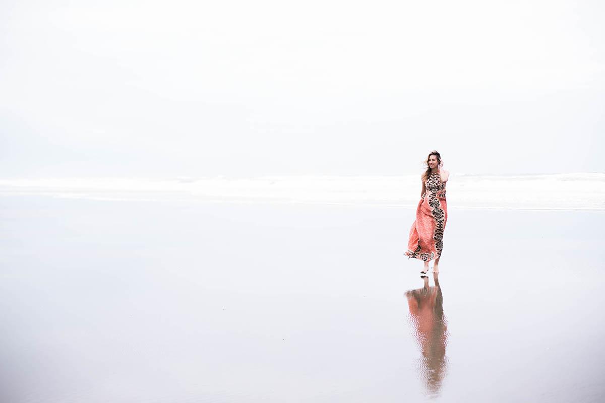 Amanda Holstein on the beach in Anthropologie Botanique Maxi Dress for beach formal wedding