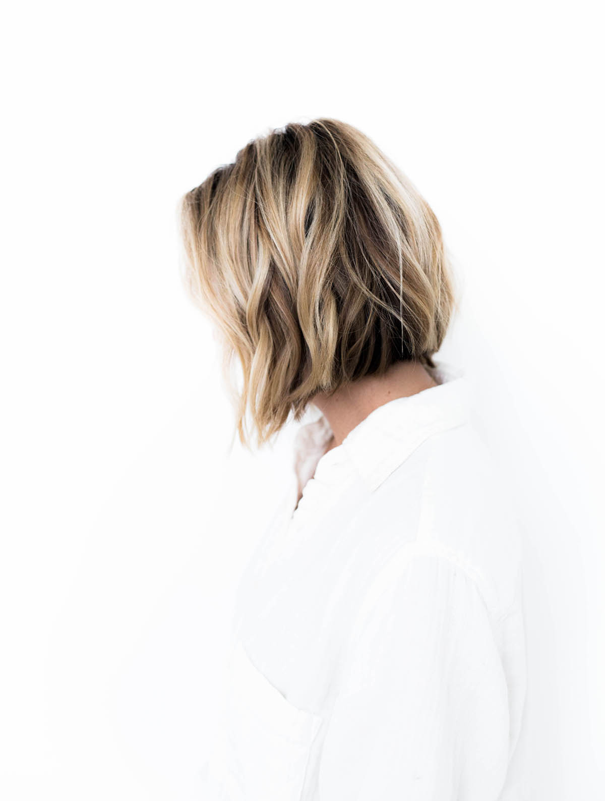 blunt bob haircut with cool sandy blonde highlights