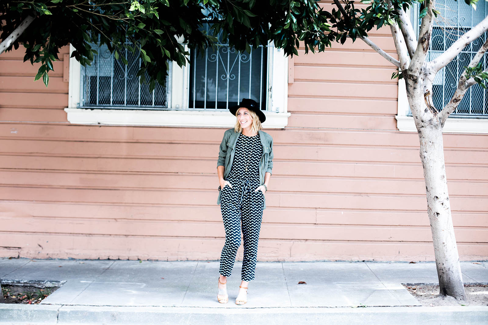 Amanda Holstein in Old Navy printed jumpsuit outfit and utility jacket