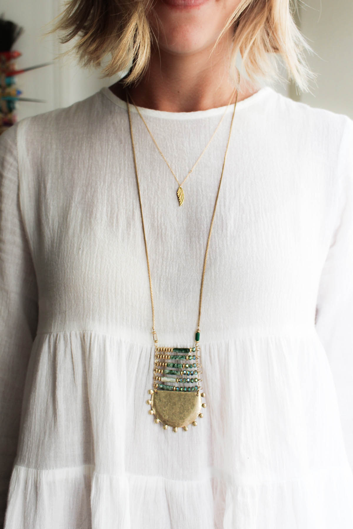 how to layer necklaces with a bohemian style