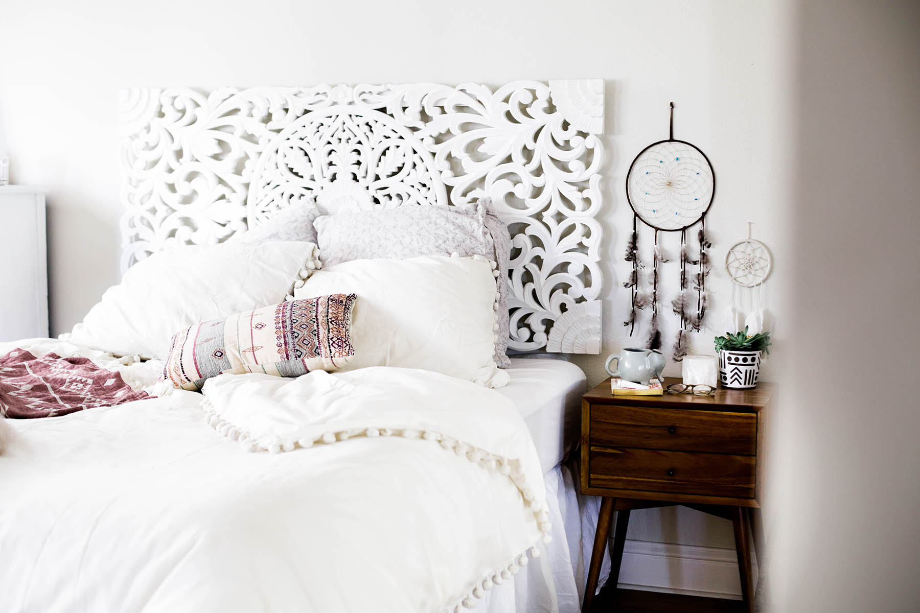 Urban Outfitters bedroom with Magical Thinking Pom-Fringe Duvet Cover and Agda Printed Yarn Pillow and Sienna Headboard