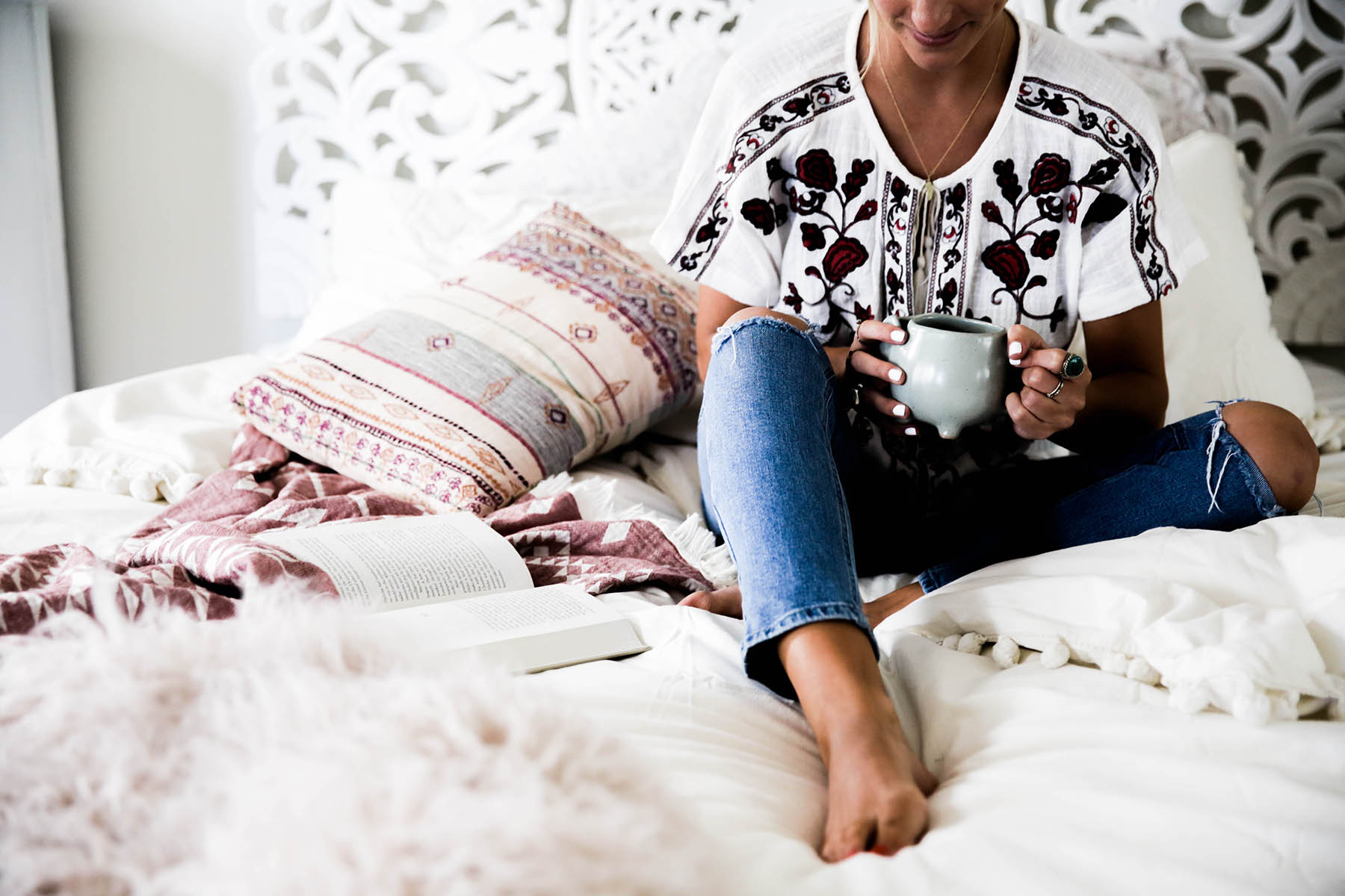 coffee in bed with Urban Outfitters Magical Thinking Pom-Fringe Duvet Cover and Agda Printed Yarn Pillow