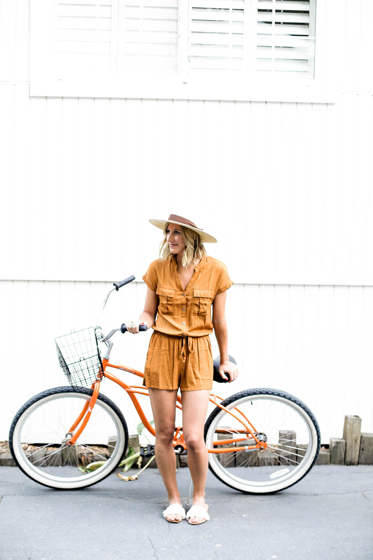 Amanda Holstein in Old Navy romper and woven fedora hat
