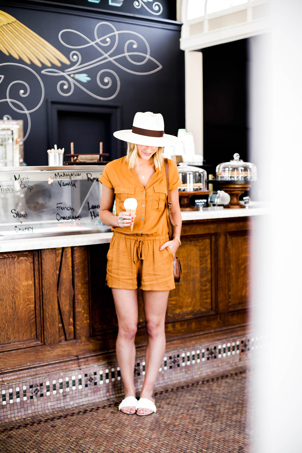 Amanda Holstein in Old Navy romper and woven fedora hat at Guerneville Bank Club