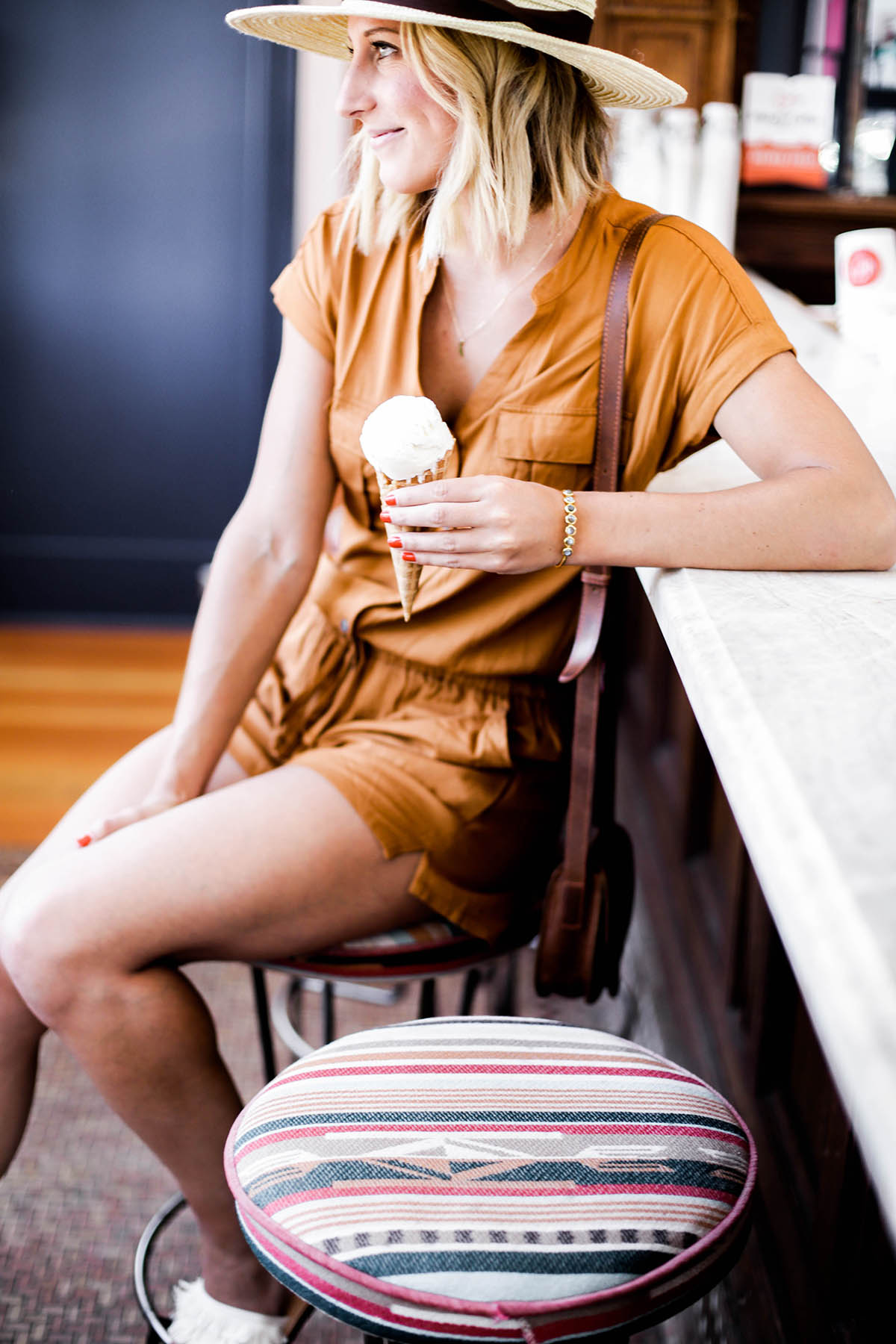 Amanda Holstein in Old Navy romper and woven fedora hat at Nimble & Finn's ice cream