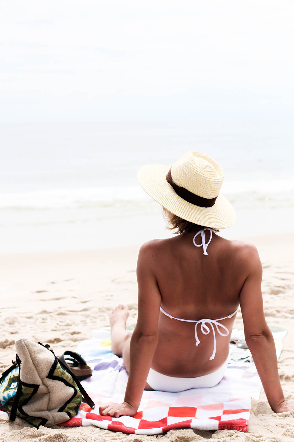 laying out at southampton beach in white bikini in summer