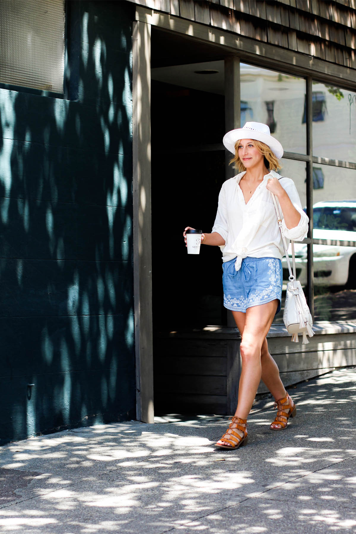 Goodnight Macaroon embroidered drawstring shorts and Free People white button-down shirt
