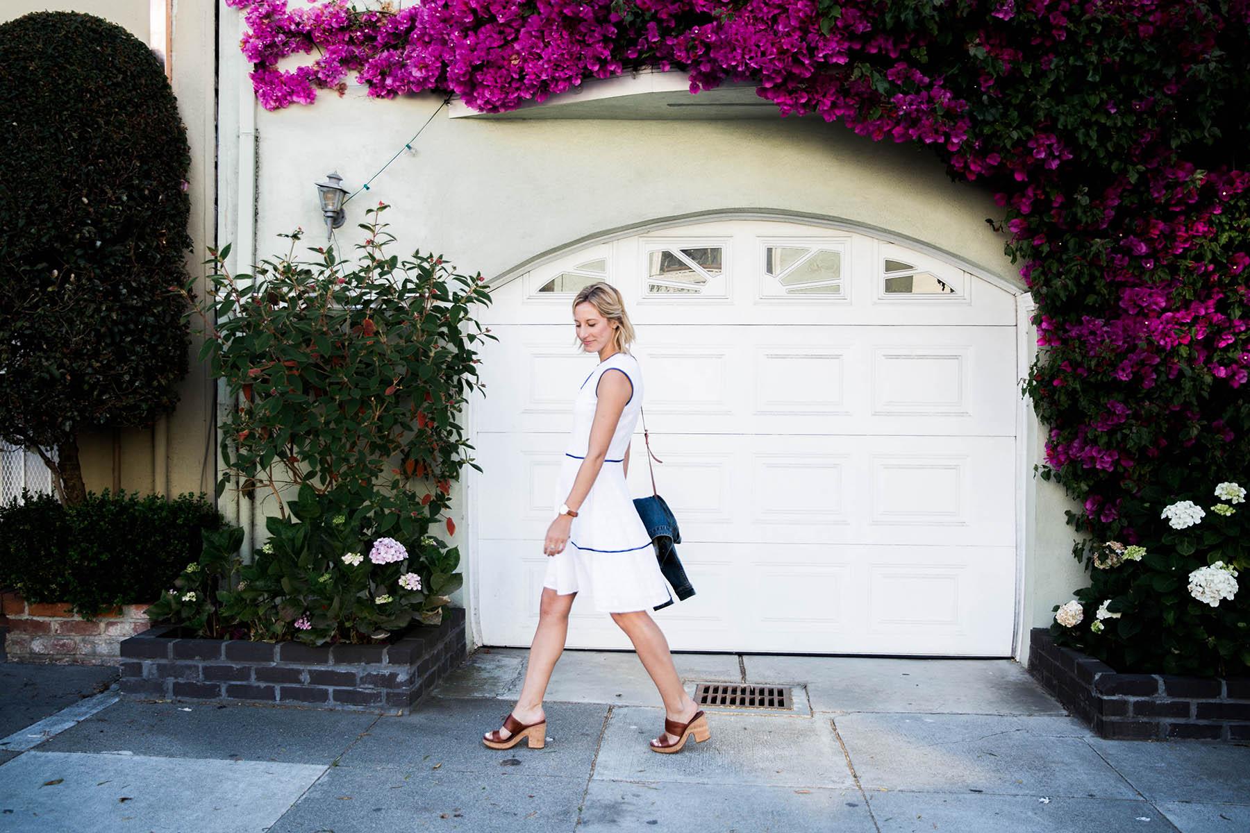Amanda Holstein walking in Draper James white dress sundress