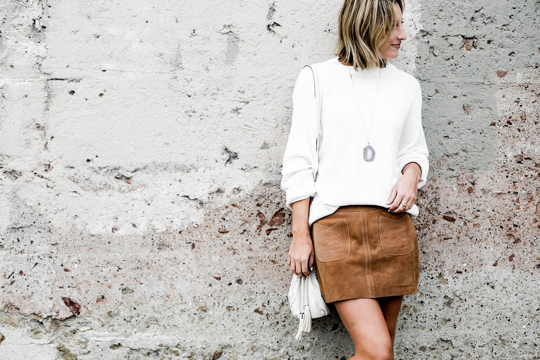 fall fashion trends free people suede miniskirt and oversized sweater and lucky brand cutout booties