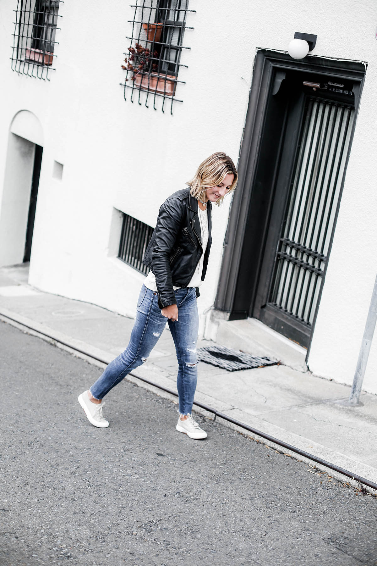 black leather moto jacket with madewell distressed skinny jeans and superga sneakers