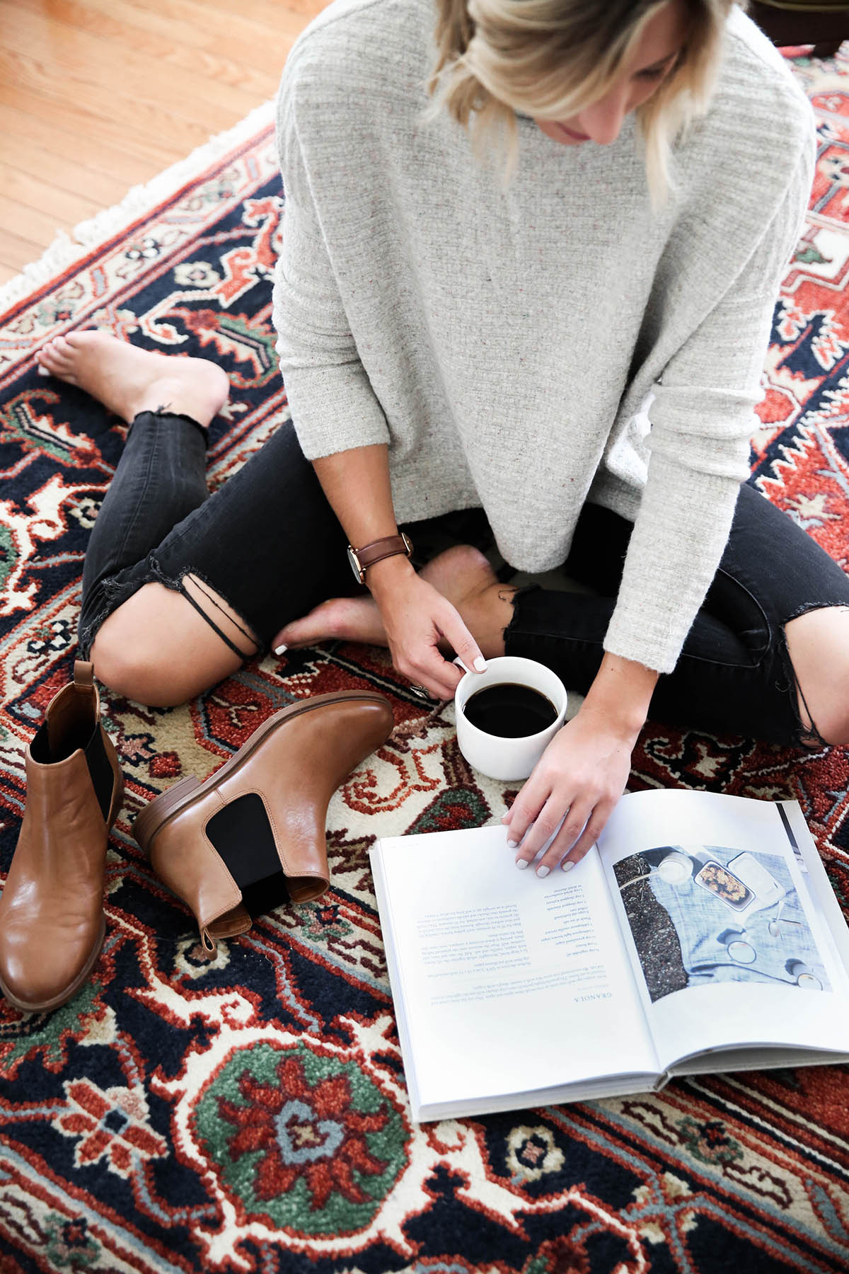 free people arctic fox sweater with chelsea boots and black distressed skinny jeans on antique rug