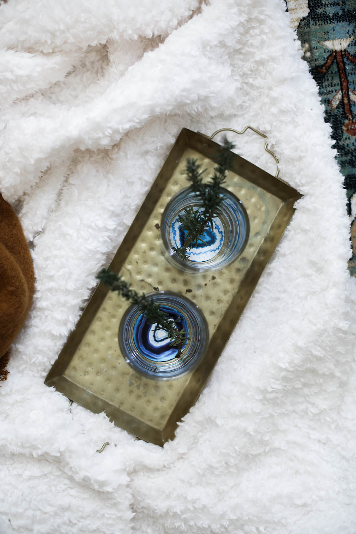 urban outfitters geode bottom glasses with gold tray and fleece throw blanket