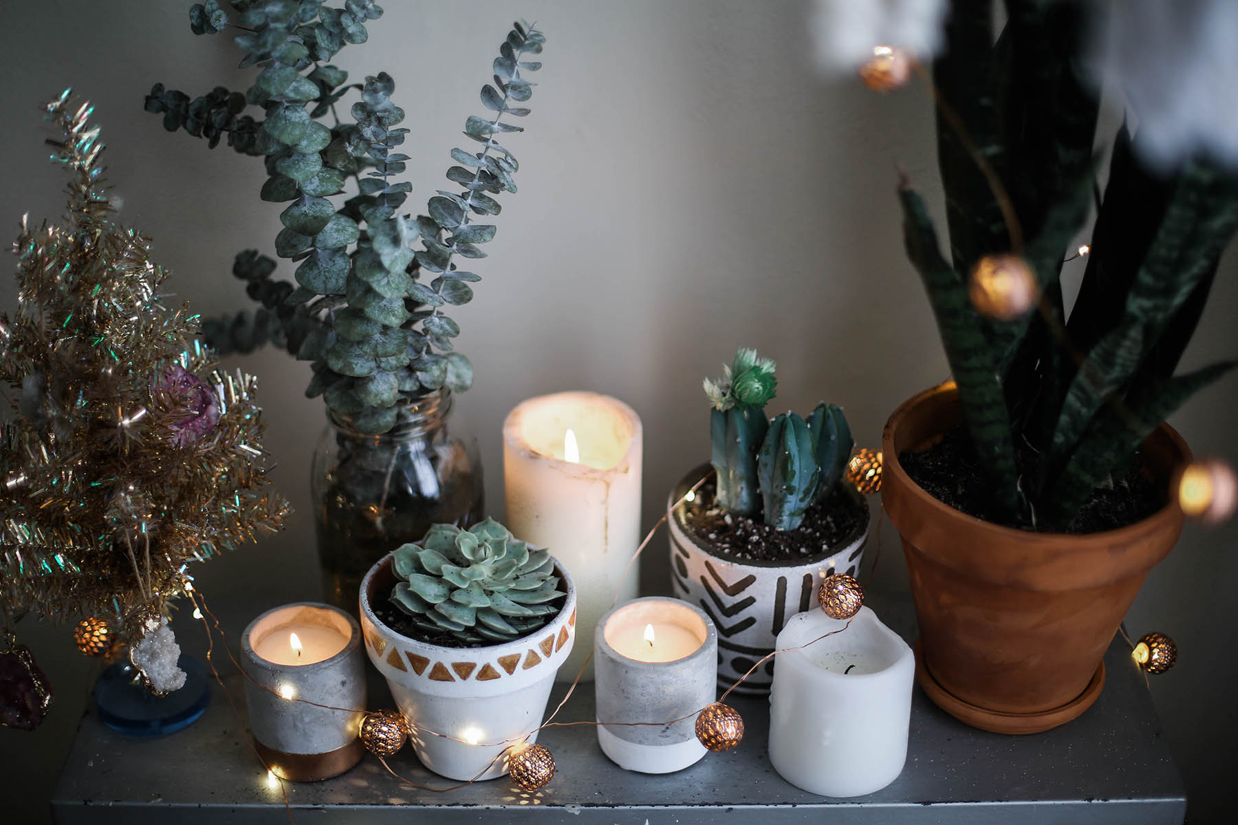 candles, succulents, and planters for cozy bohemian holiday decorations with Urban Outfitters home