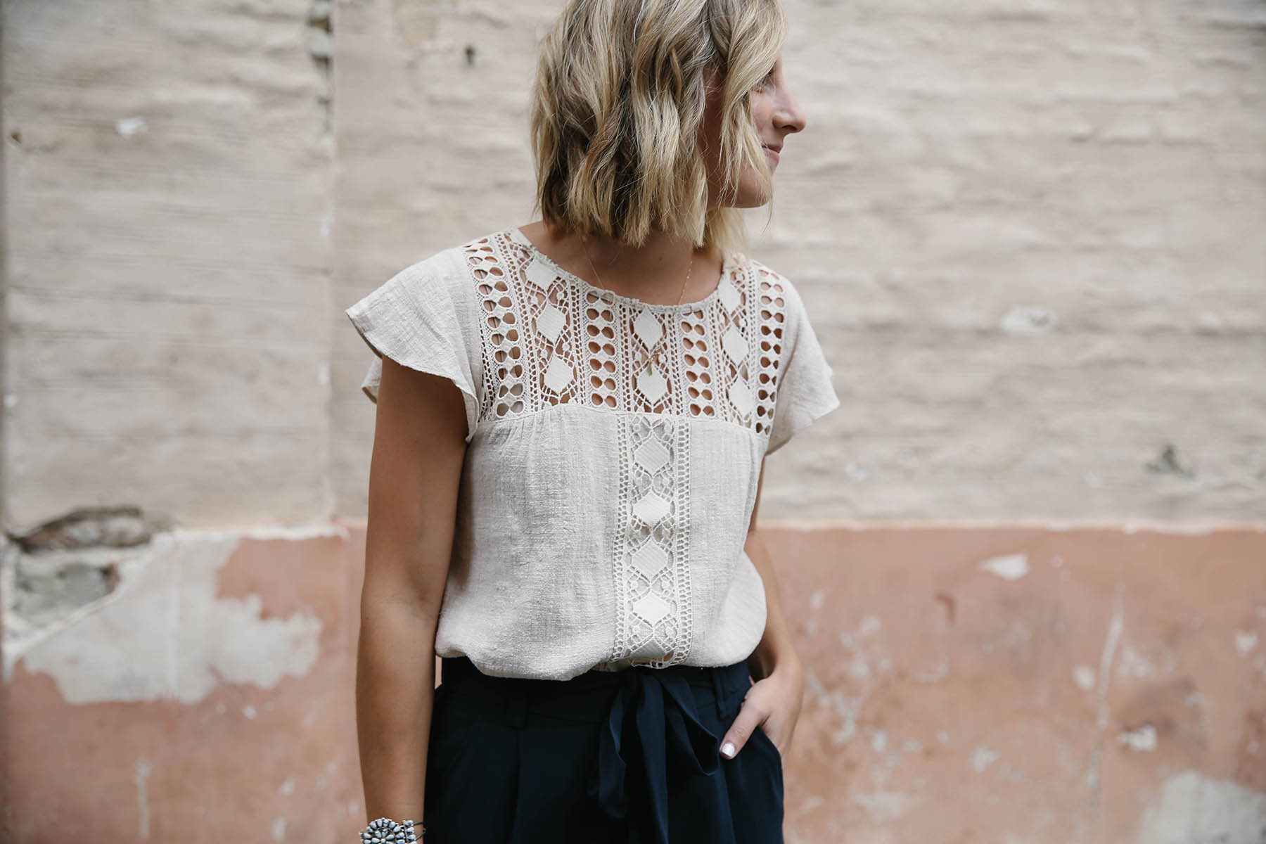 navy culottes outfit with crochet top and short blunt bob hairstyle