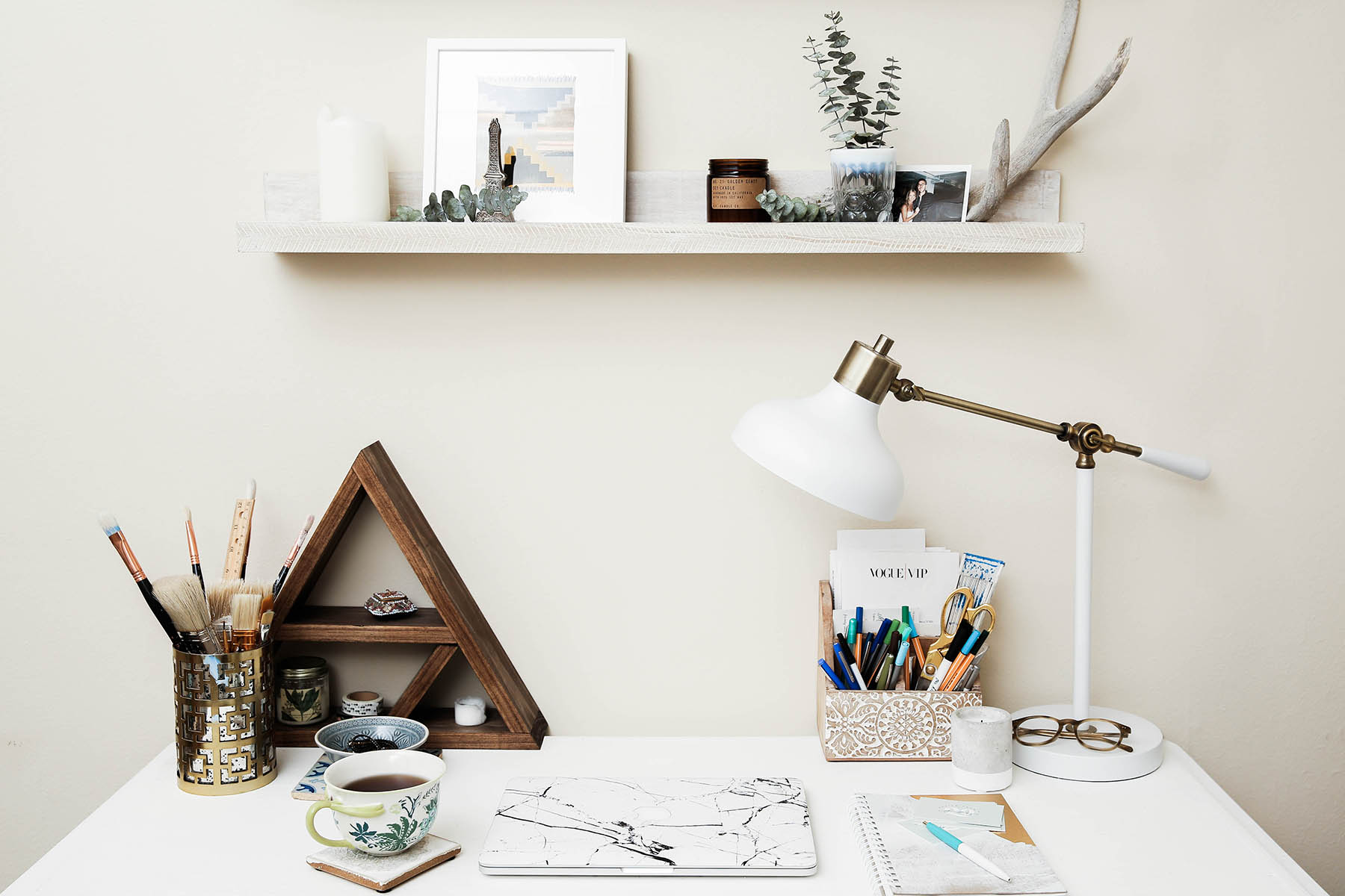 home office desk with Minted prints and shelves