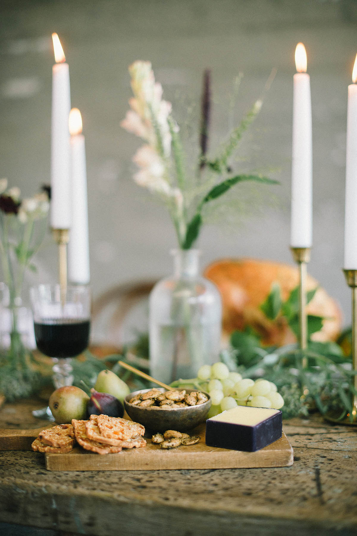 cheese plate at rustic friendsgiving tablescape decor