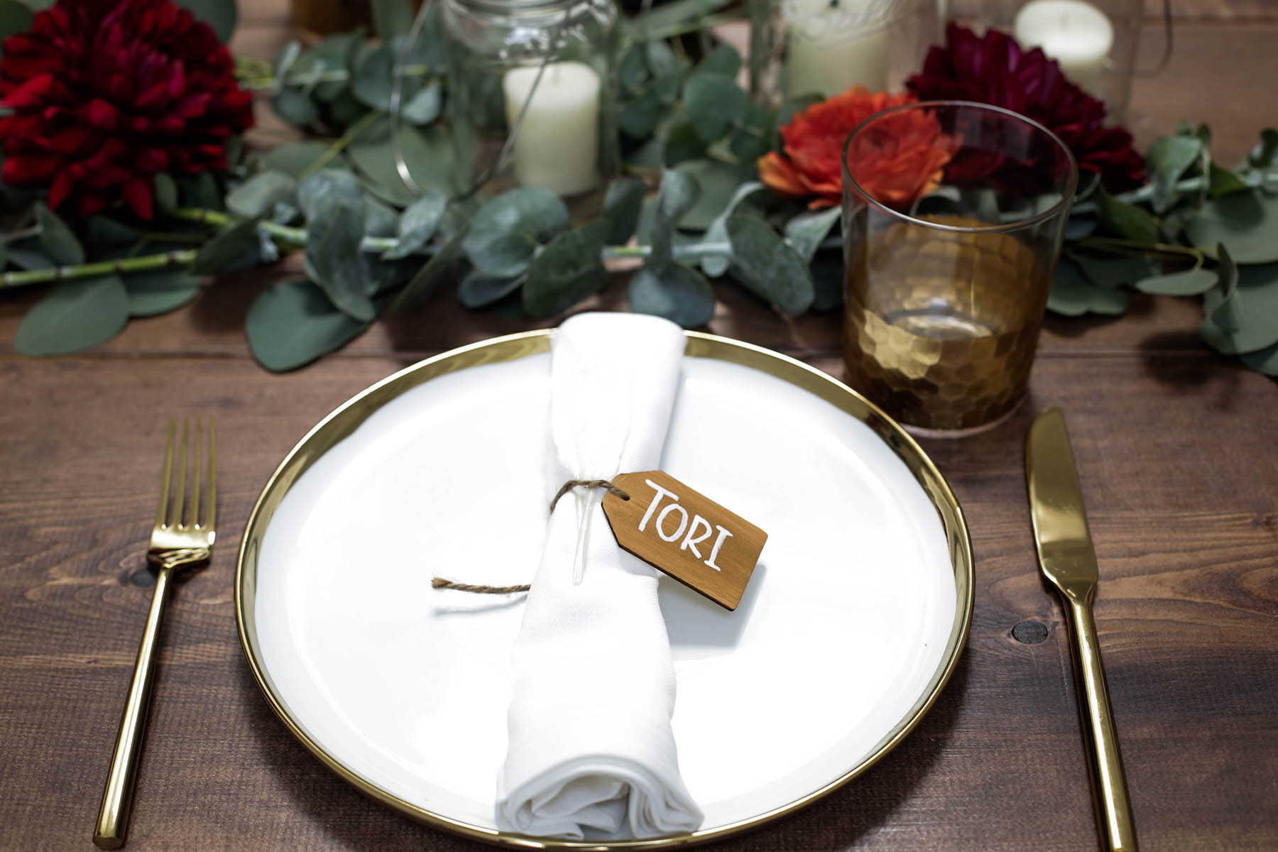 DIY name tags for natural bohemian holiday tablescape with gold flatware, candles, mason jars, florals and eucalyptus