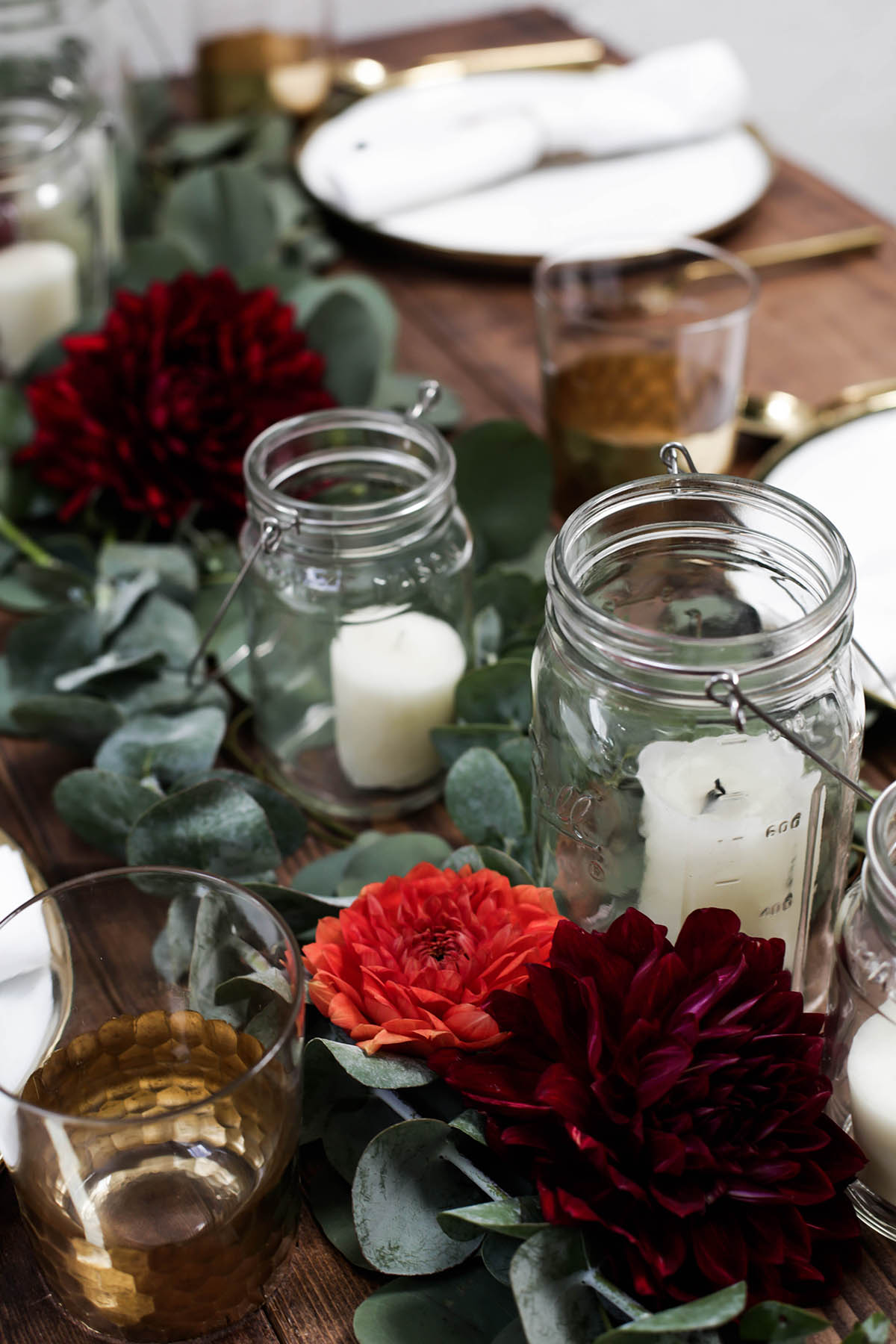 DIY holiday tablescape centerpiece candles mason jars eucalyptus and flowers