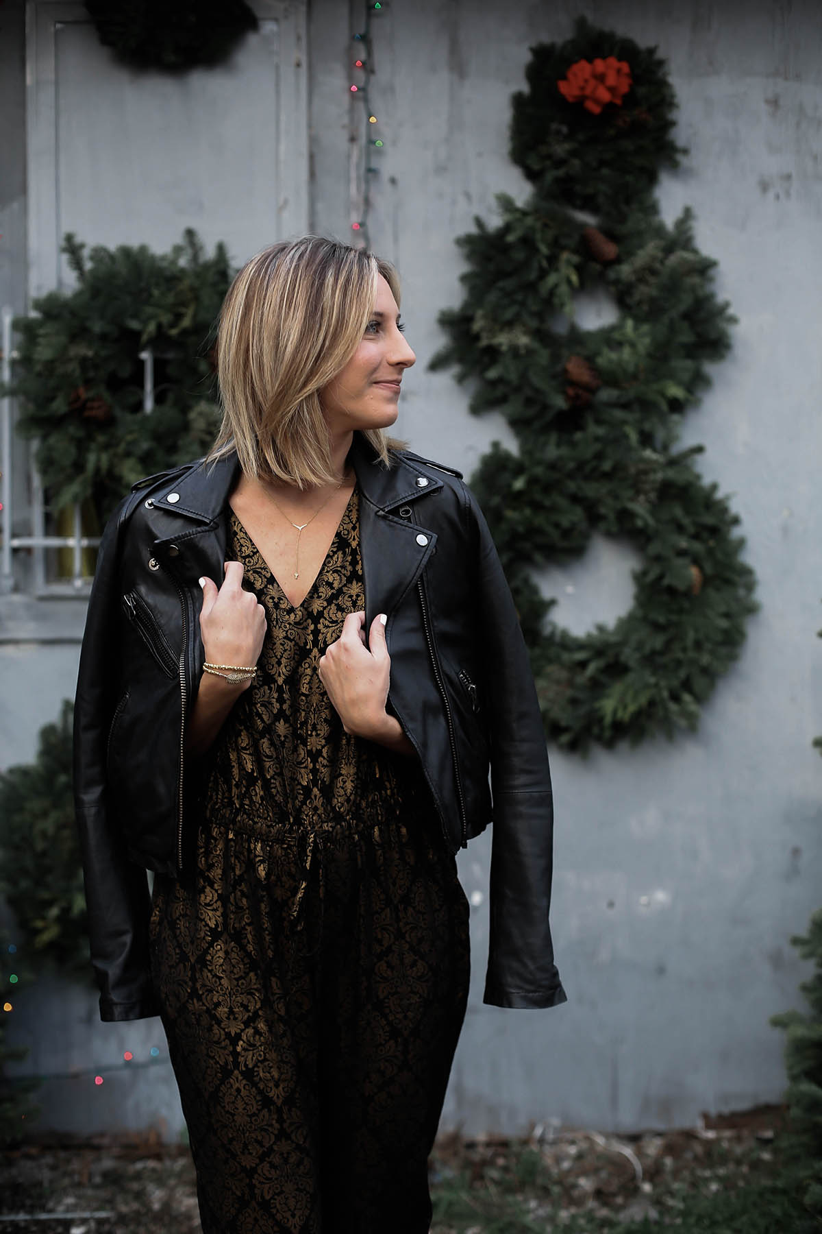 holiday jumpsuit and leather moto jacket