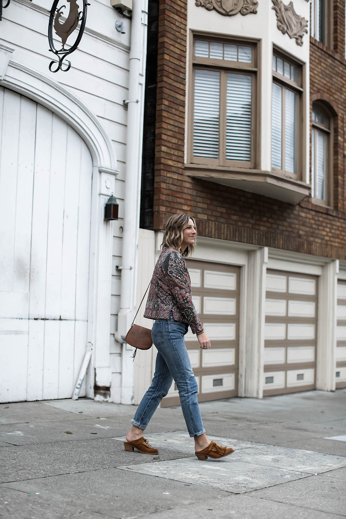 anthropologie statement jacket and jeans outfit