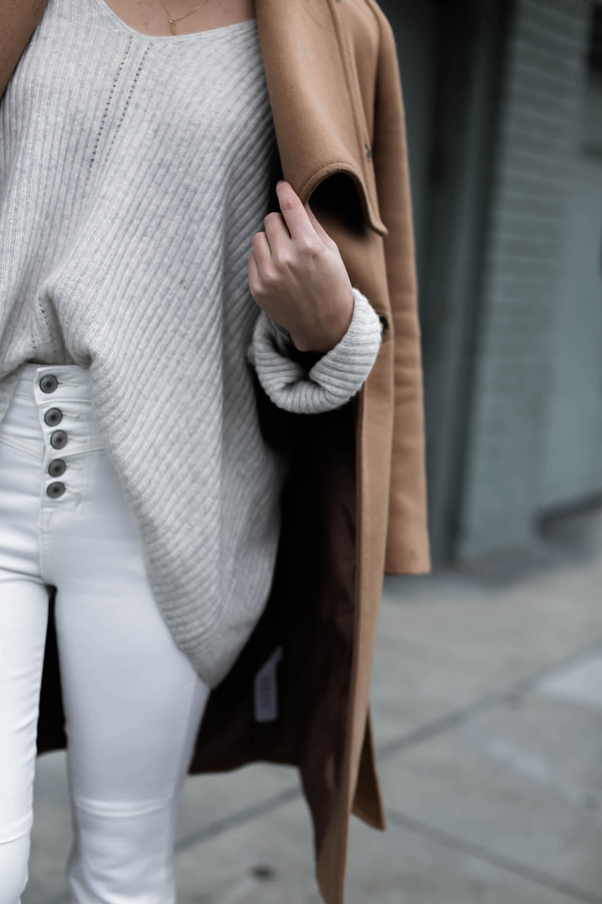 high rise white jeans and oversized gray sweater