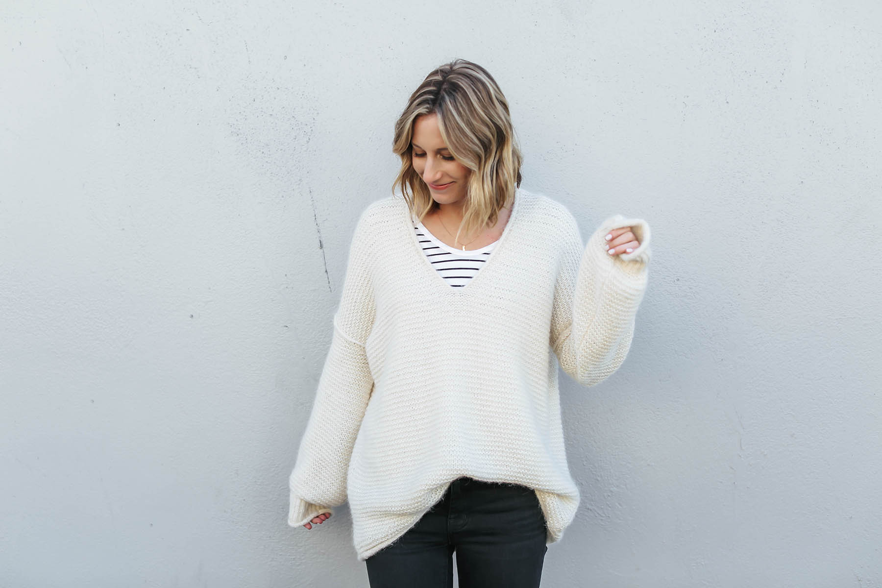 layered outfits with free people oversized all mine sweater