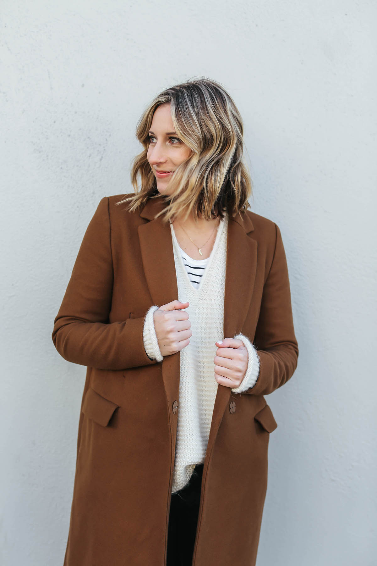 layered outfits with camel coat