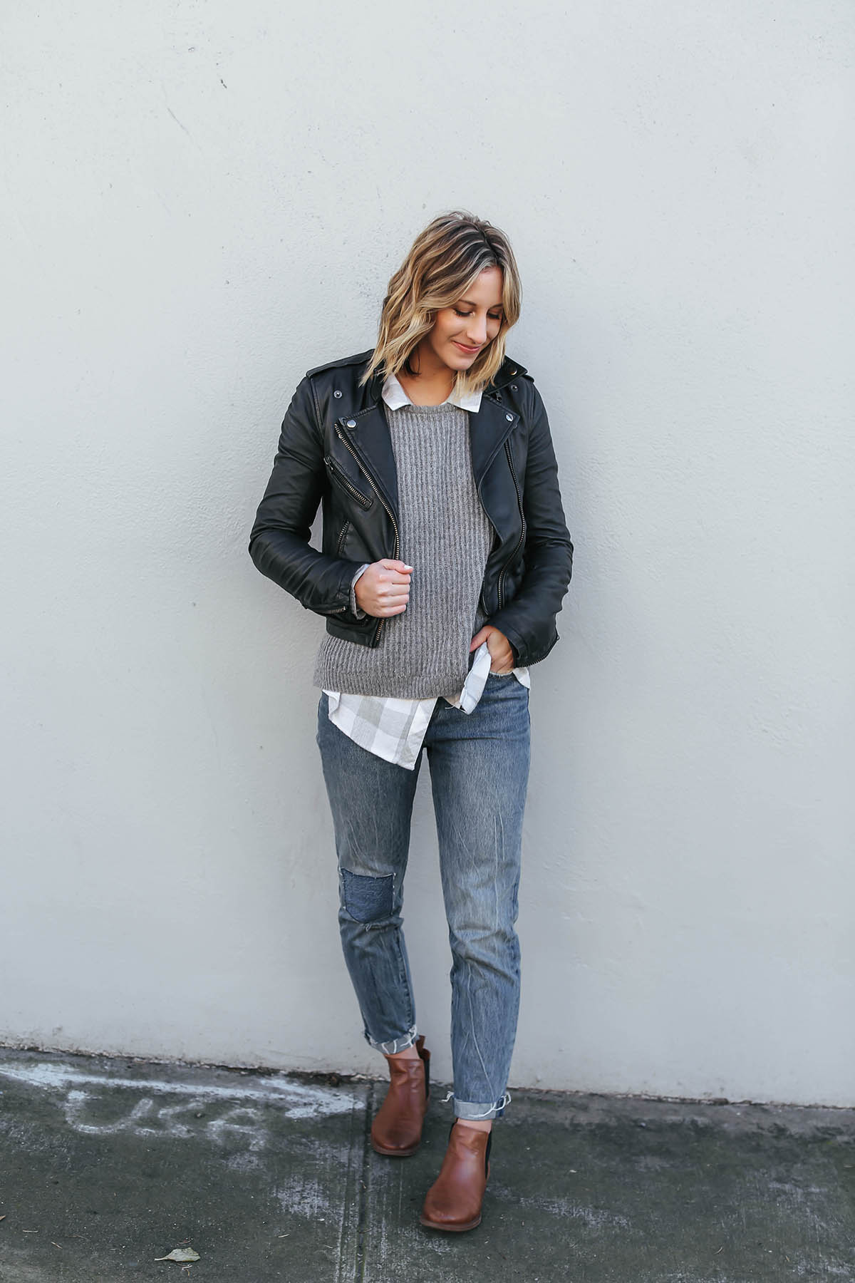 layered outfits with sweater and moto jacket