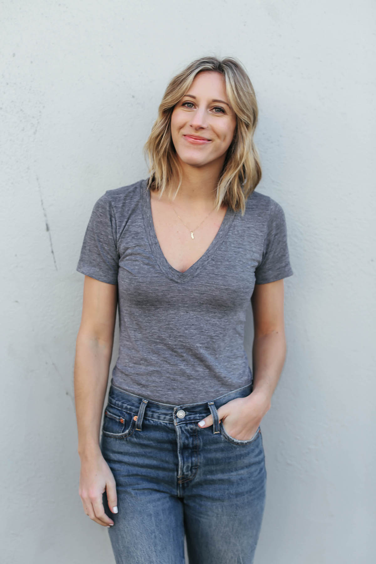 gray t-shirt and jeans